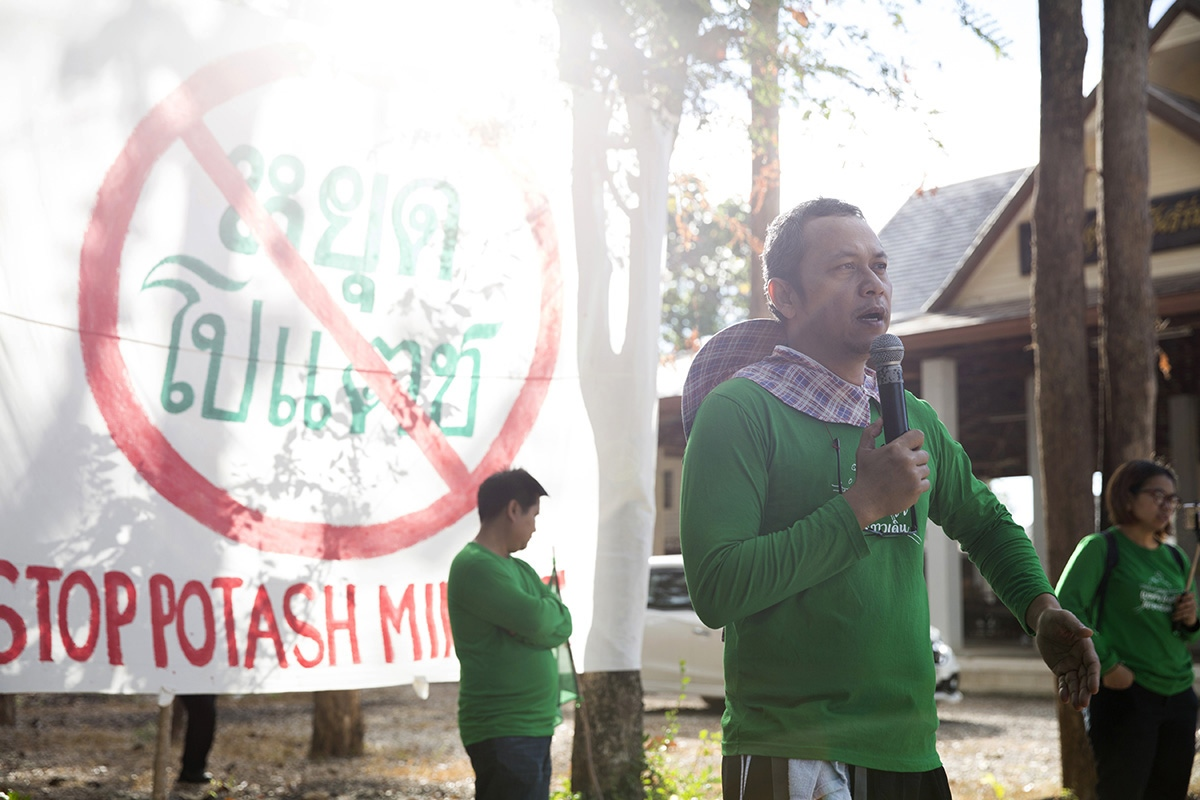 The Commoners Party chief and anti-mining activist Lertsak Kamkongsak talks with and inspires members of an anti-potash mining group on the morning of the first day of their 6 day protest walk to the Provincial capital. Approximately 200 locals gathered at a local temple in Wamon Niwat district ready to begin in December 2018.