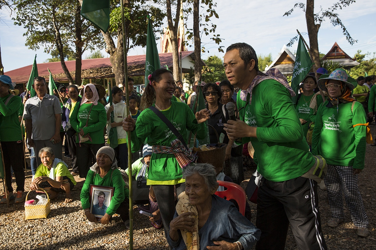 The Commoners Party chief and anti-mining activist Lertsak Kamkongsak talks with members of a anti-potash mining group that has been trying to stop the renewal of a Chinese Potash Mining Company license which they say will lead to huge environmental impact on their community and land. In December 2018 the community walked 85km over 6 days to the provincial capital to protest the company, something that was organised by Lertsak.