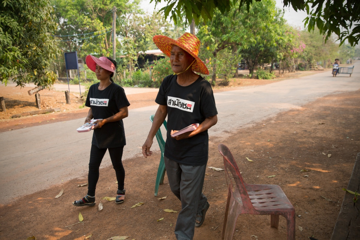 Members of the Commoners Party walk around a remote village in Sakhon Nakhon Province in Northeast Thailand, handing out flyers. Because of the policies they represent and the inequality gap that still plagues rural Thailand they have more candidates in the remote provinces than they do in central Thailand.