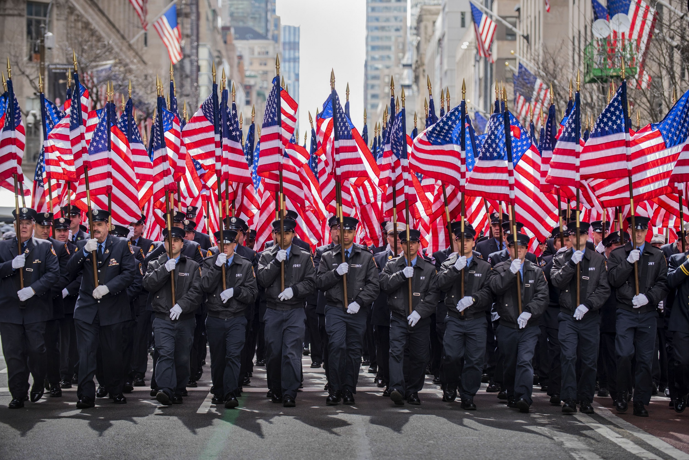 Photography image - New York City Fire Fighters Battalion carrying American flags at the 2019 St Patricks Day Parade, NYC, NY.