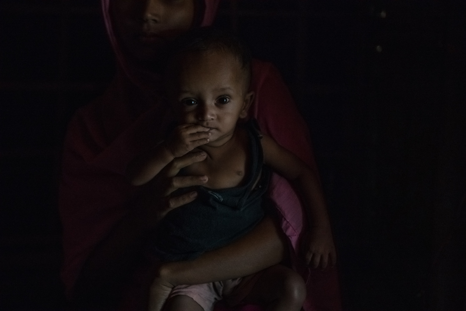 Rohingya refugee Rumana, 17, holds her ten-month-old son Mohammed Tufa, at her home in Kutupalong refugee camp. Rumana fell pregnant after being raped in Myanmar, and terminated her pregnancy