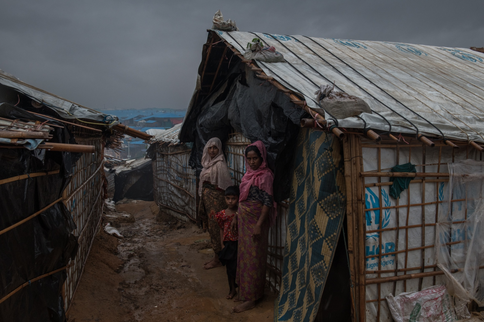 Rohingya refugees outside a shelter in the Kutupalong refugee camp