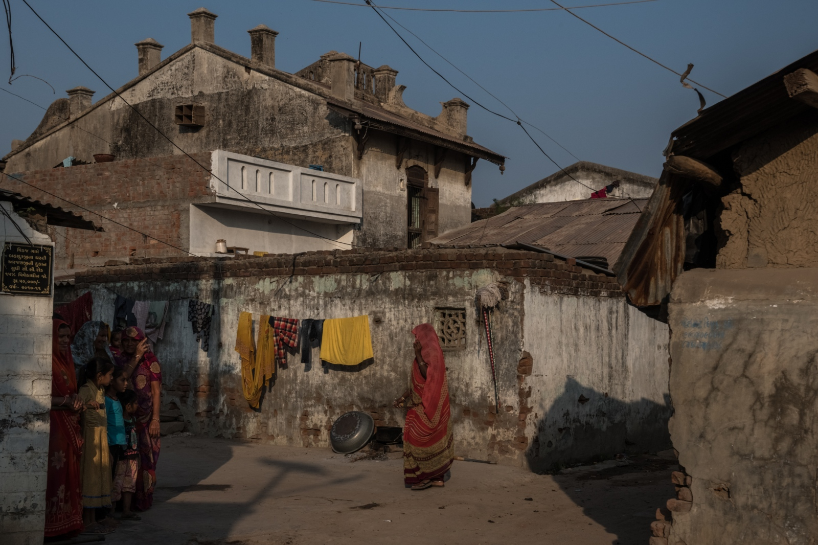 Residents of Vedaj village. The rise in oil prices — in dollars — and the fall of the rupee have lifted the cost of petroleum-based products for Indian manufacturers