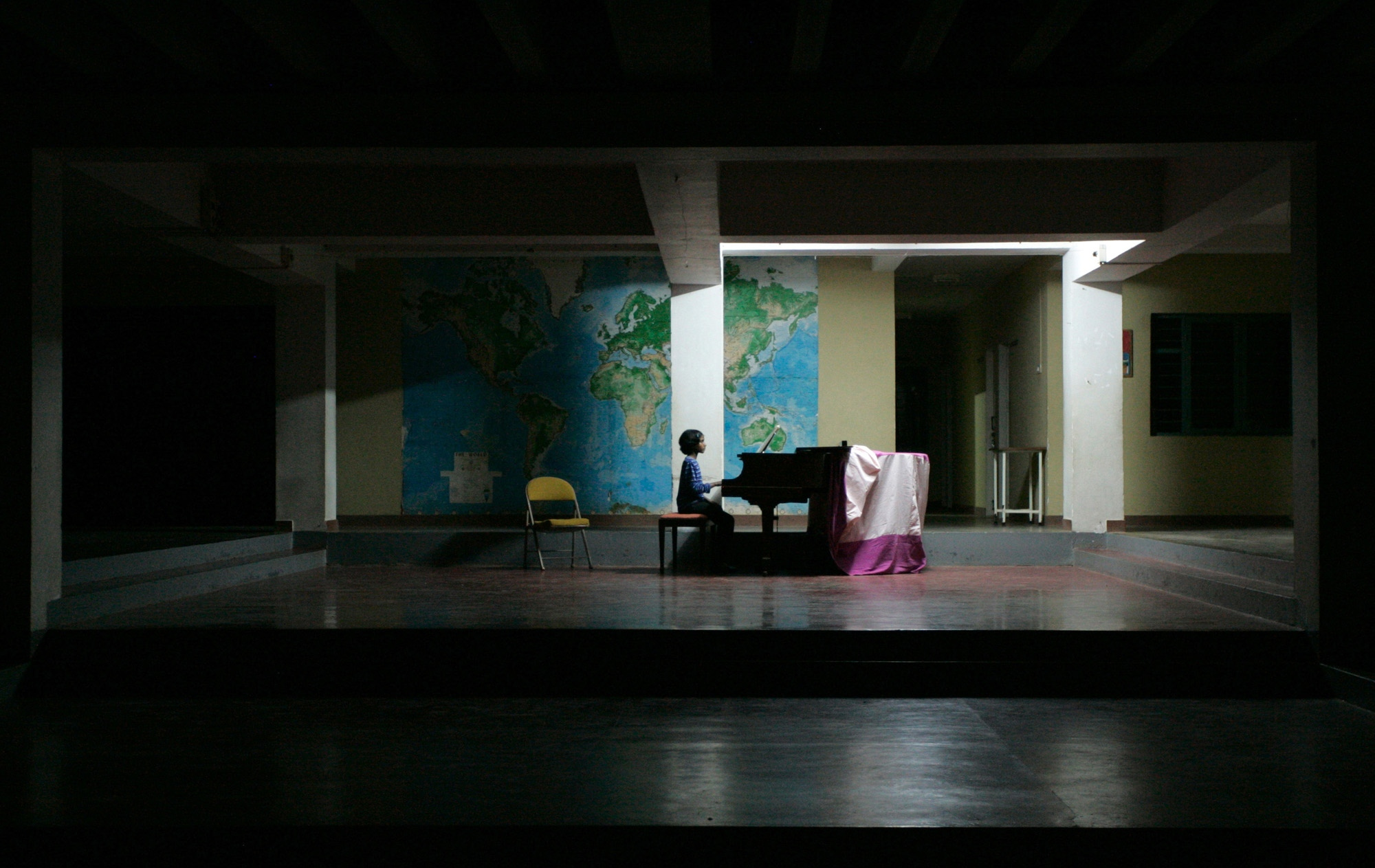 Manjula, 12, practices piano in the main school building.