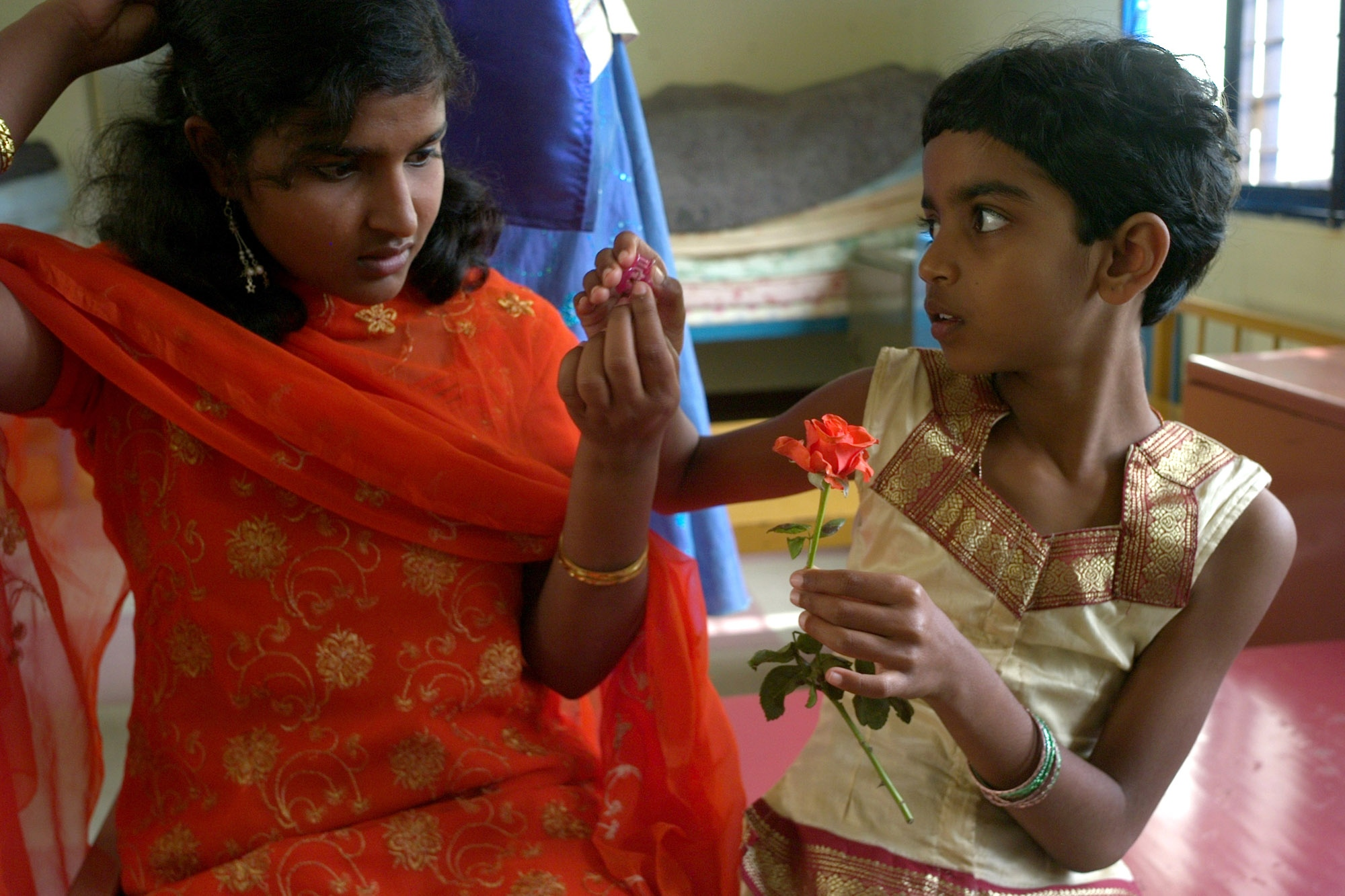 Shilpa Raj, 15, left, gets ready to see her father for the holidays after 6-months at the school.