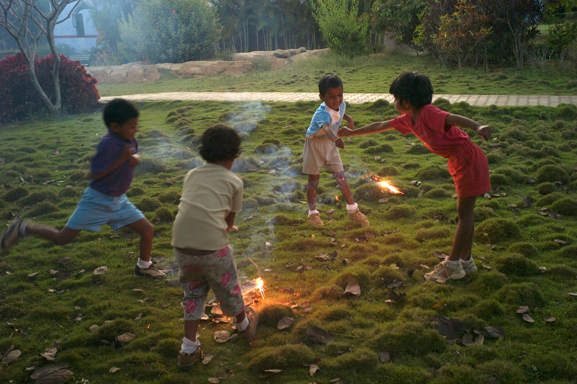 Students play with sparklers that were left over from the Indian holiday Diwali.