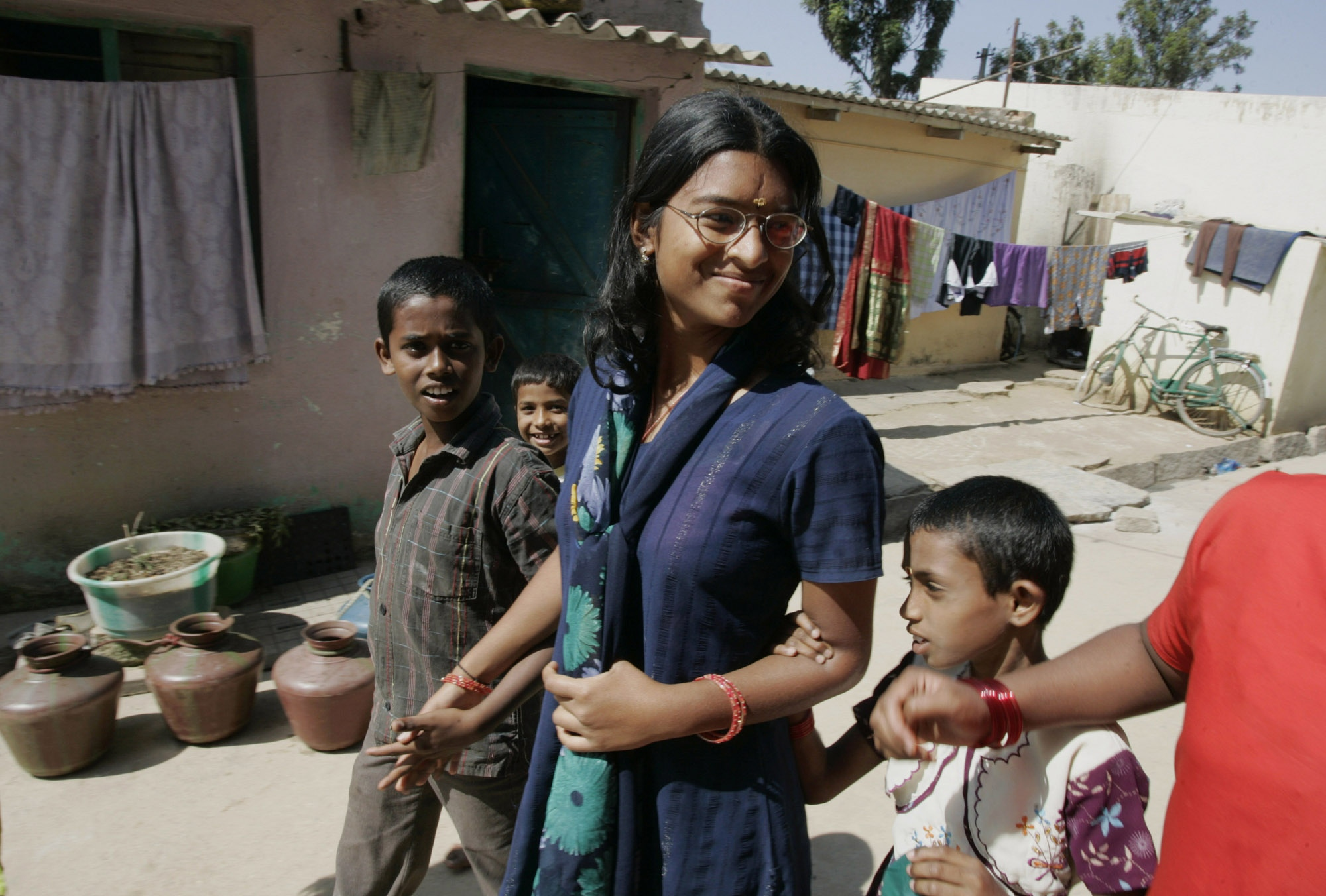 "Sindhu Subramani, 16, visits home during the Christmas break. ""I will help my mother and the village when I have a good job."" She plans on getting a degree in environmental studies."