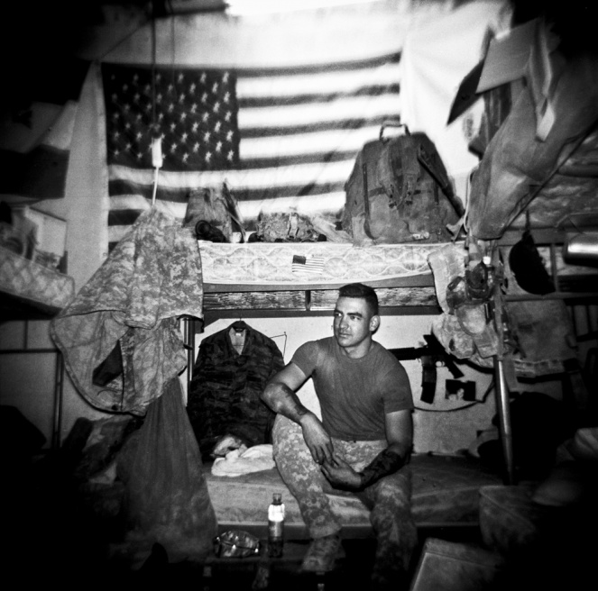 US infantry soldier (of the 3rd Platoon, Bravo Company, 1st Battalion, 32nd Infantry Regi- ment, 3rd Brigade, 10th Mountain Division) SGT Justin Chapell sits on his bed at COP (Combat Operating Post) Charkh in the south of Logar Province, Afghanistan.