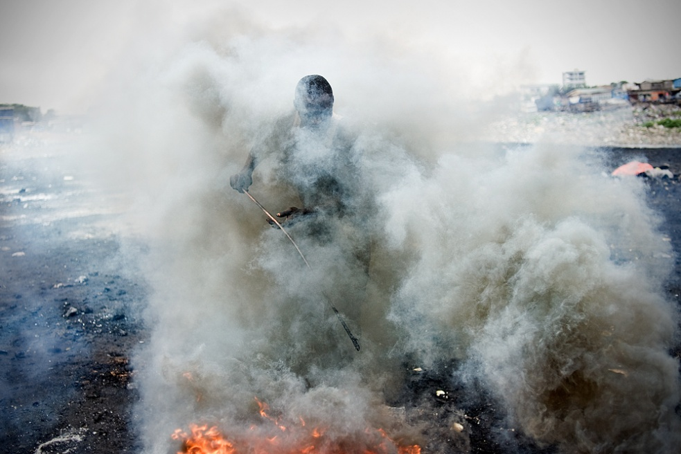 September 2011- Ghana, Accra. The work on the dump is very stressful and hazardous. Young people burning e-waste cables for the copper. According to a Basel Action Network/ Greenpeace study, the toxic smog is likely to cause sterility, asthma, cancer and neurological disorders.