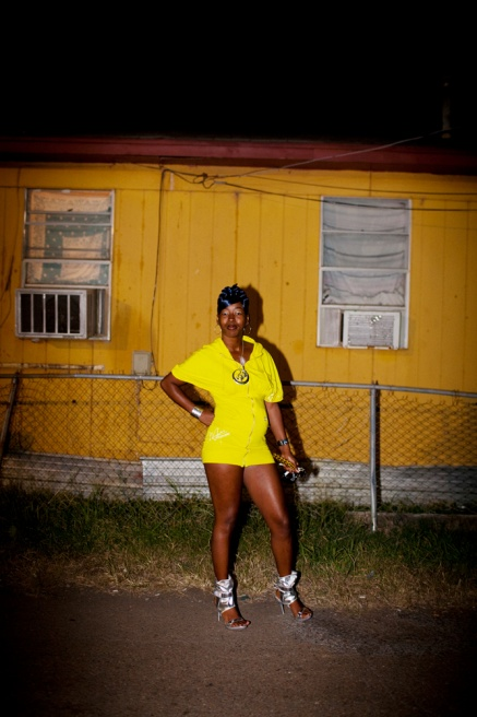Sonya Maggit strikes a pose, showing off her outfit, in the Baptist Town neighborhood of Greenwood, Mississippi before going out clubbing on September 25, 2010.