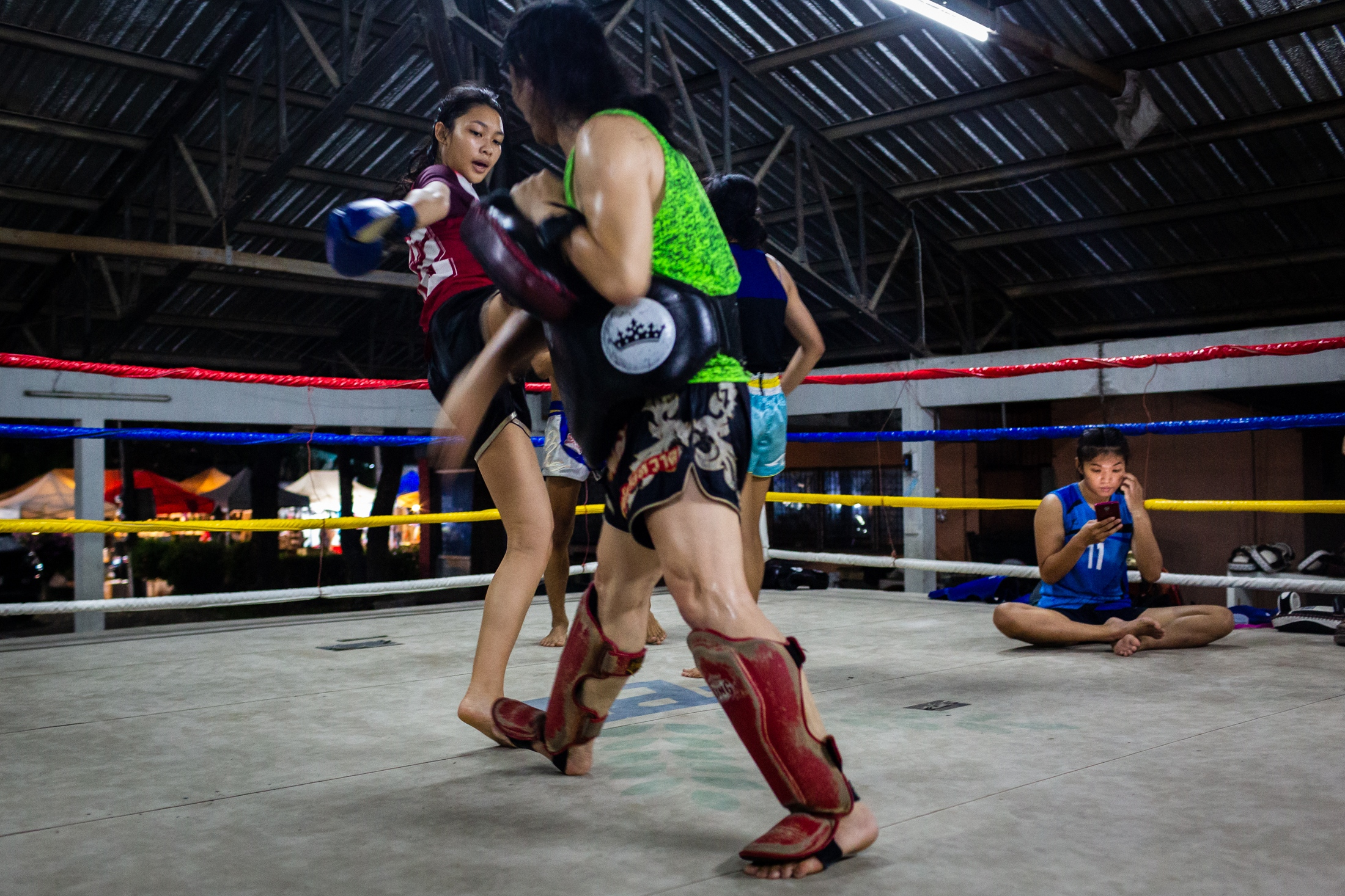 Peem practices her kicks, while a friend waits for her turn, during a training session at the Muay Thai Sakchatree gym in Chiang Mai, Thailand, 29th September 2018. In gyms like Sakchatree, women already overpass the number of men learning Muay Thai, especially in Chiang Mai, where a local promoter sees the sport as a way to promote equality. All girls are allowed to practise free of charge in Sakchatree gym.