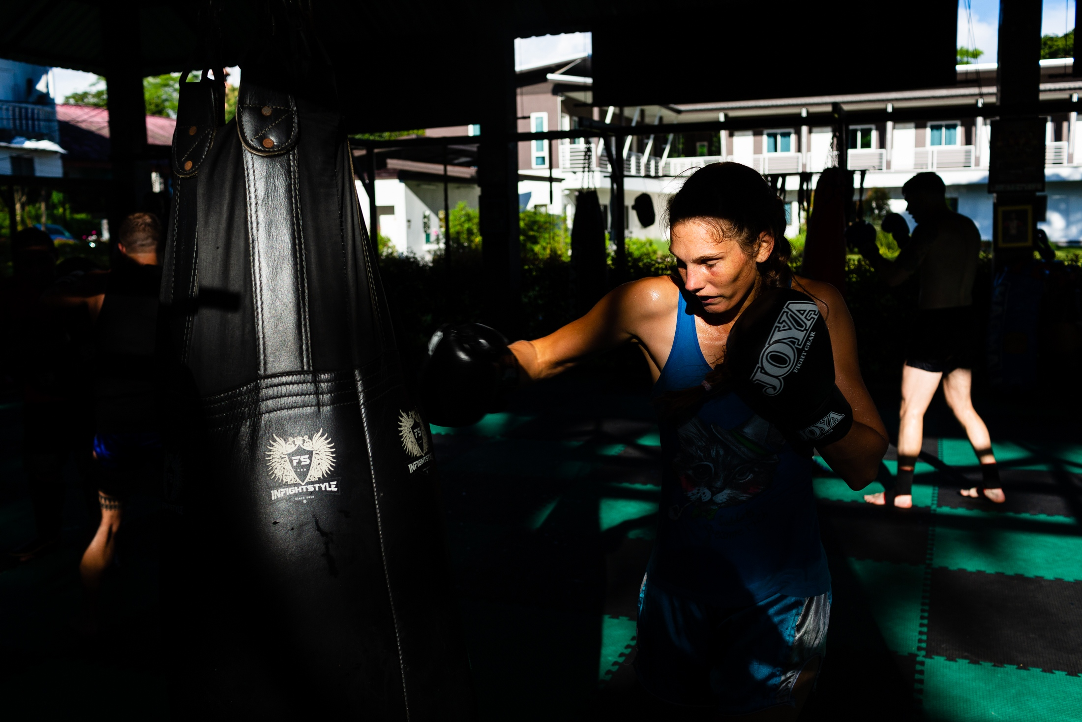 Lisanne van der Molen practices punches on a boxing bag during a training session at the Hongthong gym in Chiang Mai, Thailand, 20 th September 2018. Lisanne is one of the many foreigners that come to Chiang Mai to practice Muay Thai. She practices in Thailand because here she can fight regularly in a professional environment. In South America or Europe, she struggles to find enough fights. Originally from Holland, she now represents Peru, her husband and coach country, in international competitions. Lisanne won the gold medal at the Pan-American Games in 2016, 2017 and 2018 and got a bronze medal during the Muay Thai World Cup in 2017.