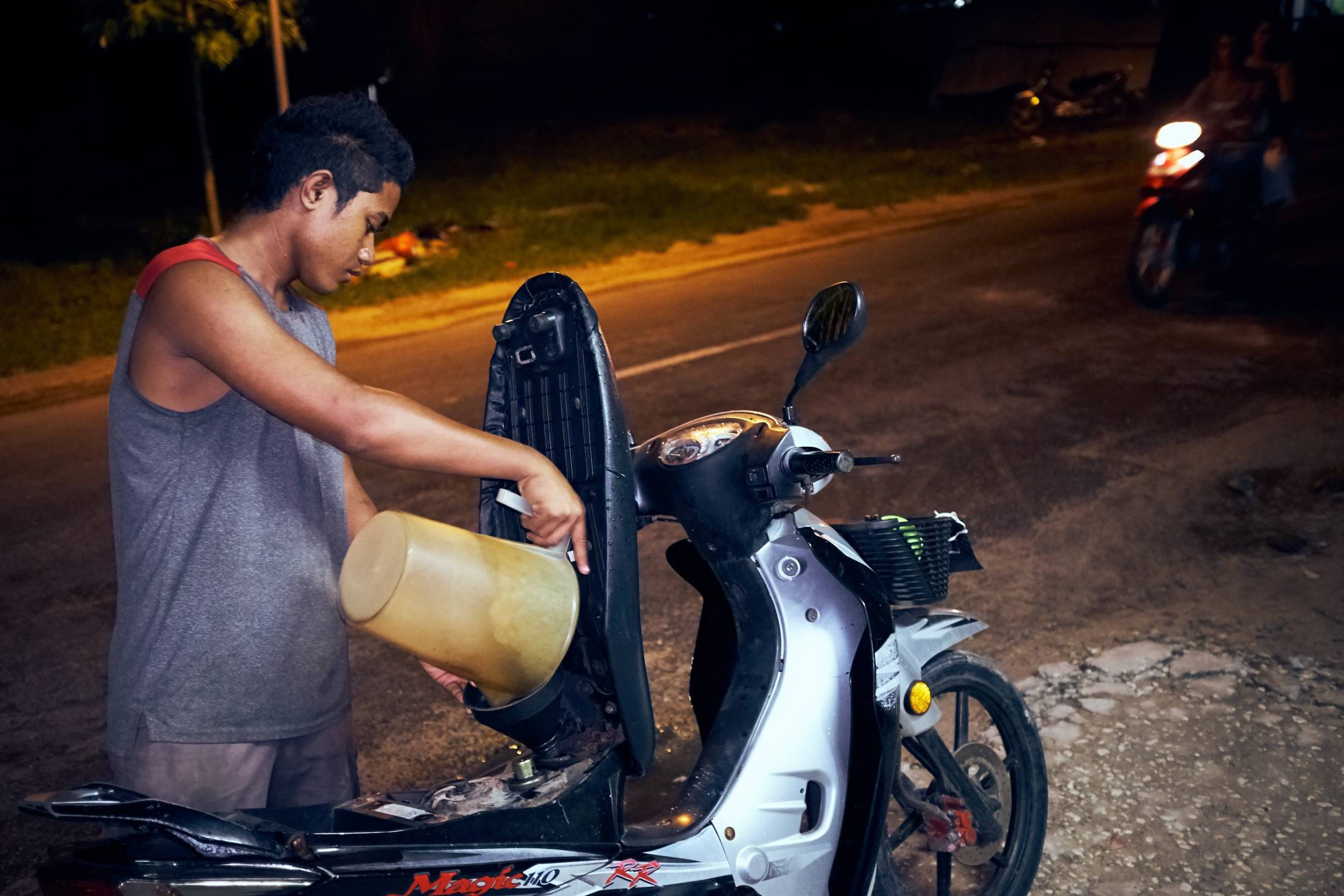 How to fill a scooter with gas, Tuvalu style.