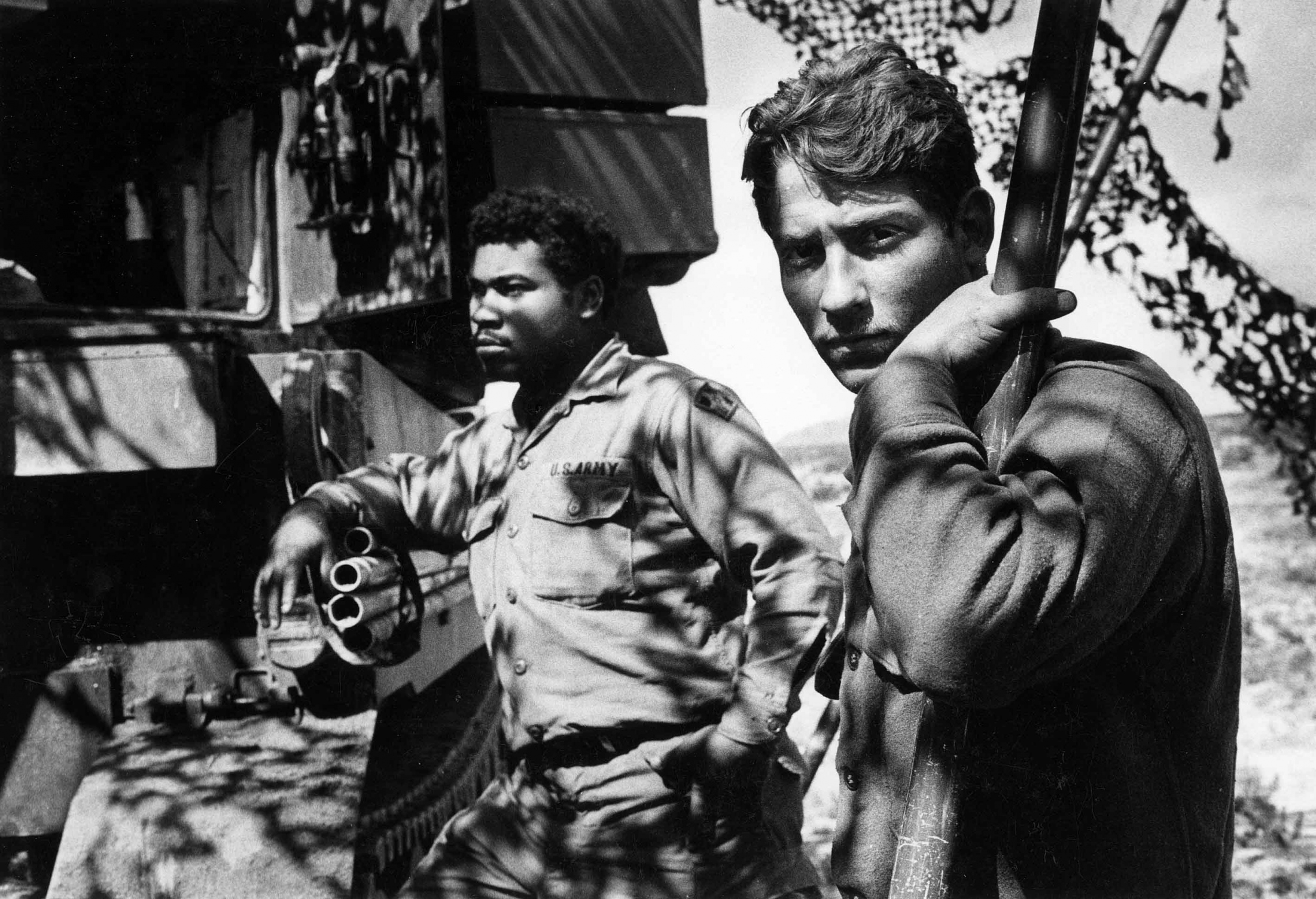 U.S. Army soldiers at rest during Operation Red Flag in the Mojave Desert, sometime around 1976, 1977. The Vietnam War had just ended about a year earlier and feelings toward the military were still sour as evidenced by these men's expressions. Or maybe they were just really tired.