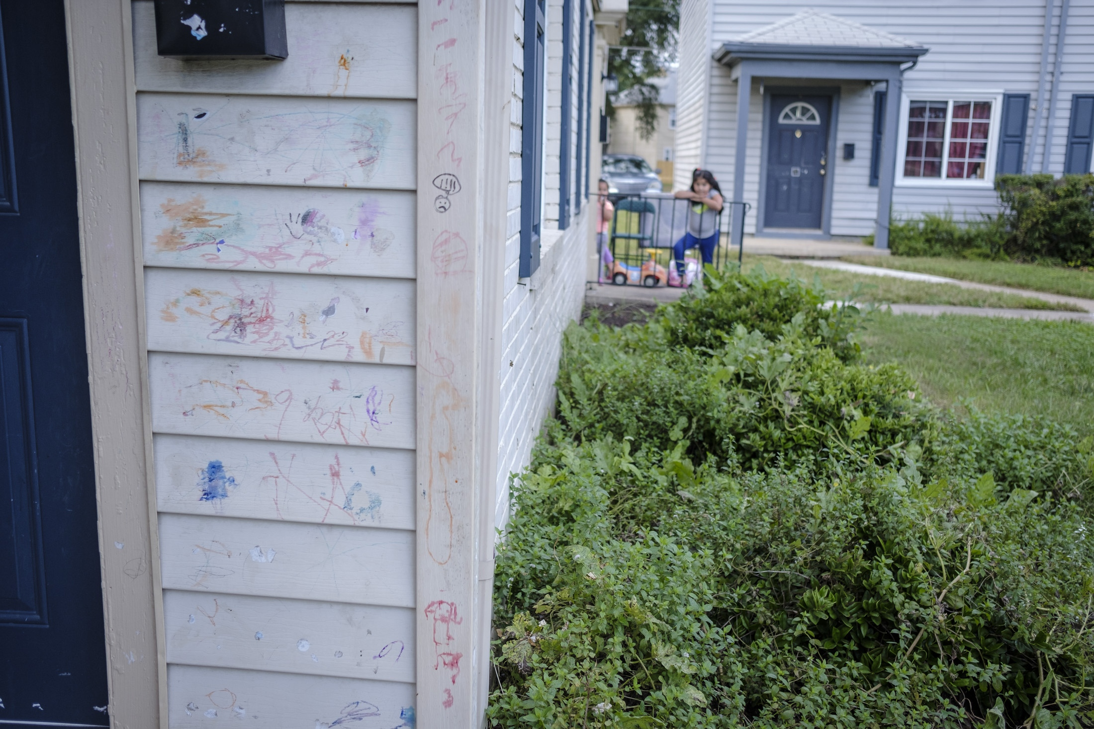 Some drawings that kids in the neighborhood drew in the walls of Maria's last home before she left to the sanctuary.