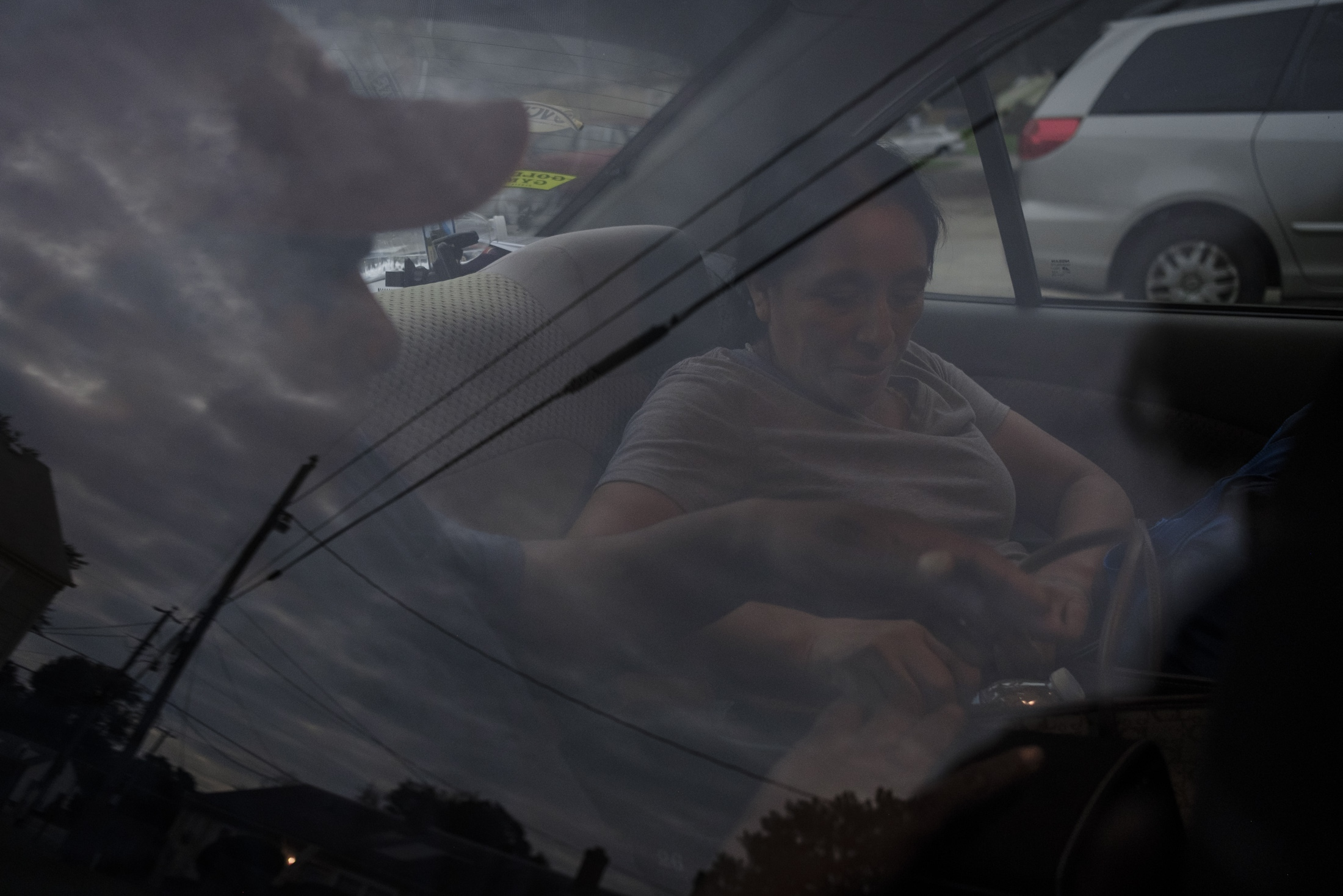Maria at the car that will be her only way out of the persecution received by ICE.