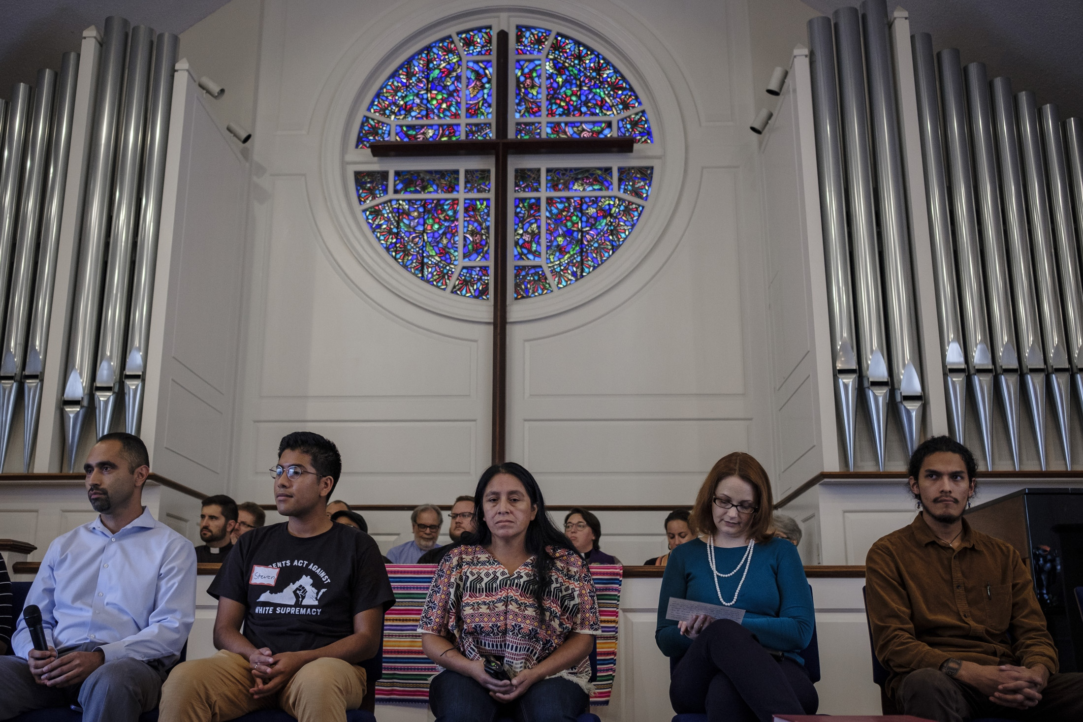 Maria about to speak during her press conference where they publicly express that Maria has been accepted into sanctuary by the Wesley Memorial United Methodist Church at Charlottesville. At her back Pastors of different religions beliefs and at her side her new lawyer Alina Kilpatrick and activists from the community.