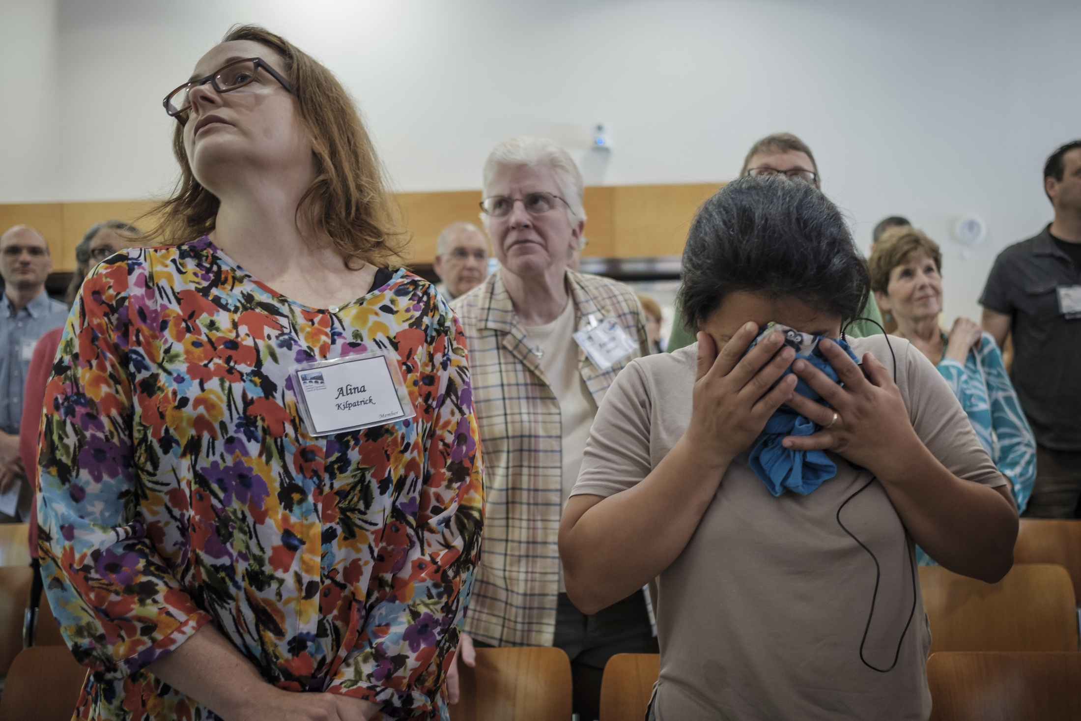 (Left to right) Immigration lawyer Alina Kilpatrick and Abbie Arevalo-Herrera during an emotional moment in the midst of Sunday service at the First Unitarian Universalist Church.