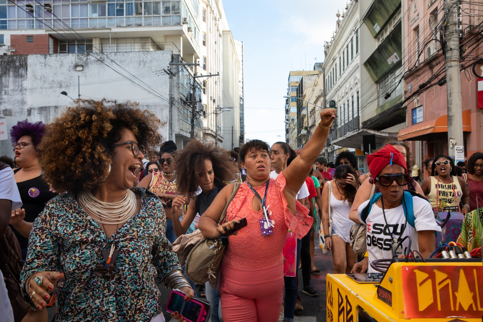 """Women at the march for the International Day of the Black Latin American and Caribbean Women organised each 25th July together with the """"Mês das Pretas"""" (Month for the Black Women) in Salvador, Bahia. The Afro-feminism and feminism in Salvador is growing strongly and mouvements, events, conferences, activities are happening frequently in town. Last year, a turning point for the feminist militants and one of the most significant event for the mouvements in Brazil, was the Angela Davis conference talk at University of Bahia, whose visit gathered hundred of women."""
