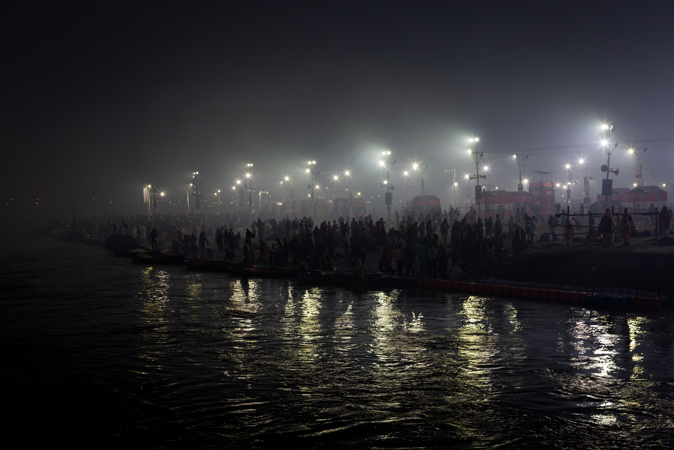 View of Triveni Sangam where pilgrims gather during the night for the holy bath not only to expiates sins but also to free one from the cycle of birth and death, Prayagraj, February 2019.