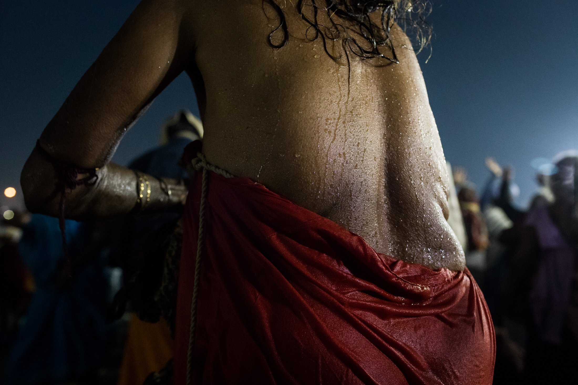 The back of a pilgrim after the holy bath in the Sangam waters, Prayagraj, February 2019.