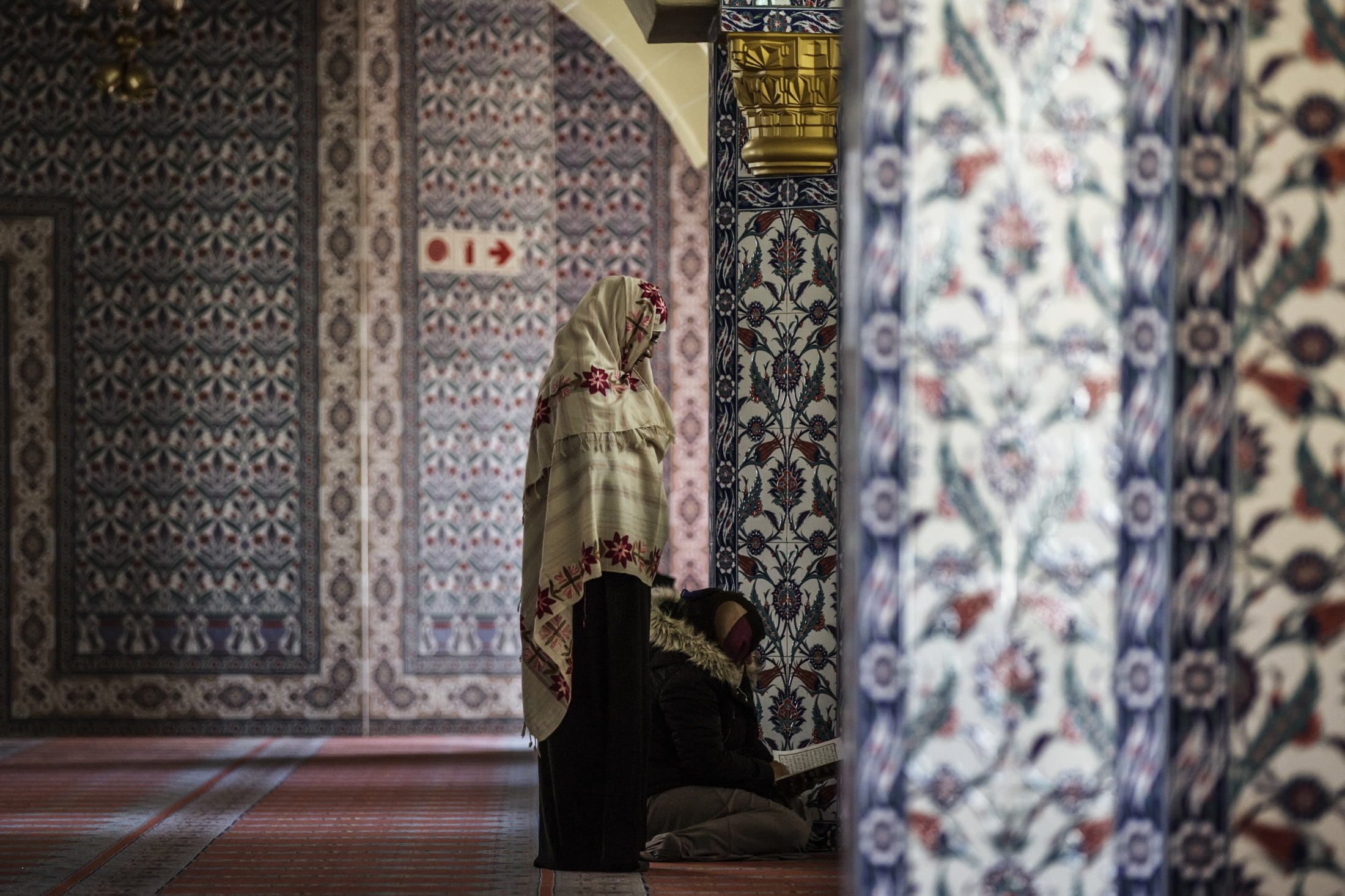Women pray salah and recite the Quran during the Muslim holy month of fasting, Ramadan, at the Nizamiye Turkish Mosque. Johannesburg, South Africa. The mosque, built by the Turkish community in South Africa, was completed in 2012 and is an adaption of the 16th-century Ottoman Selimiye Mosque which is situated in Edirne, Turkey and it, including the school, museum and shopping complex situated in Midrand is a significant marking of the Turkish community's contribution to the South African landscape.