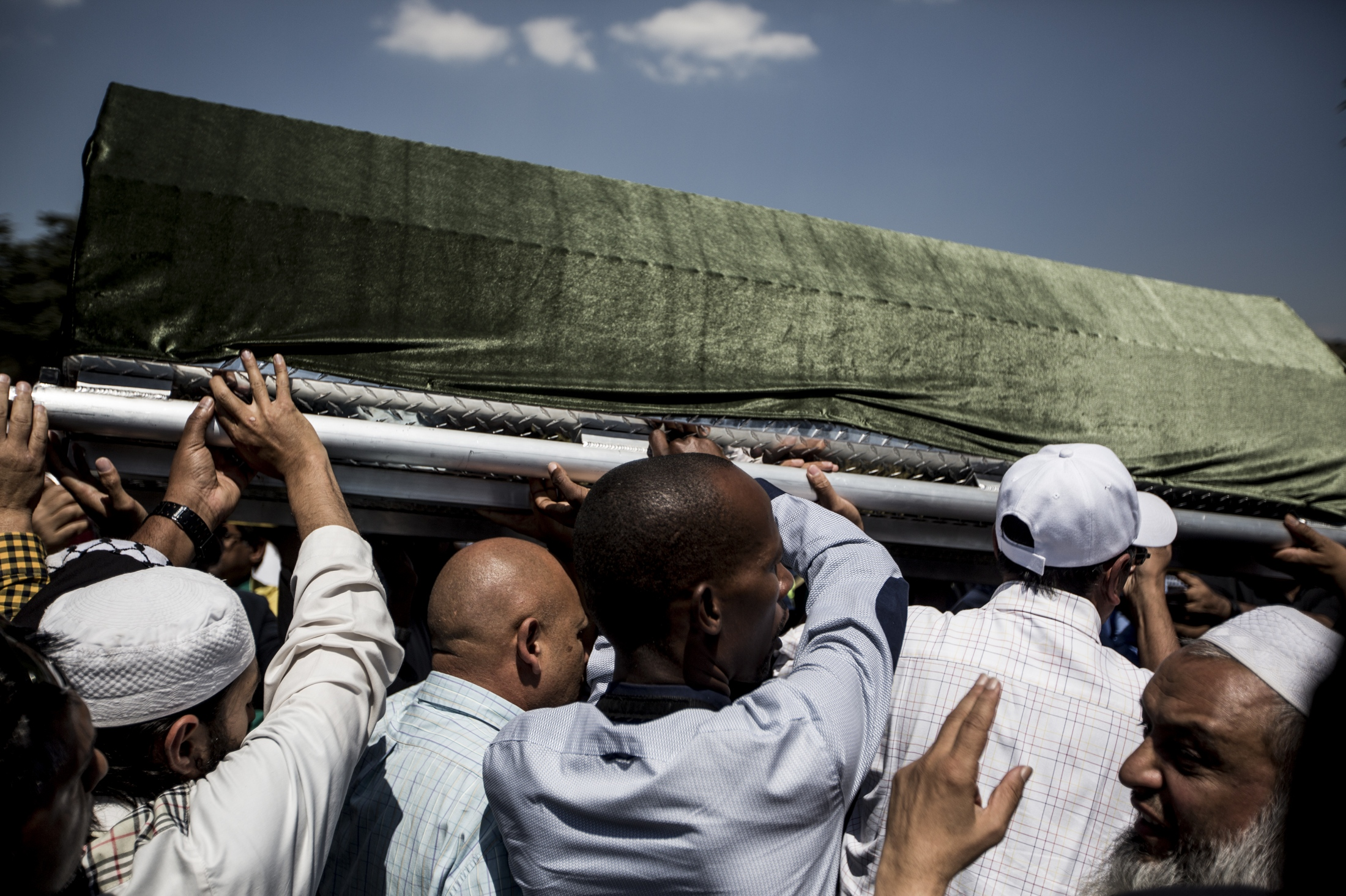Pall bearers carry the casket of Anti-apartheid stalwart Ahmed Kathrada who was imprisoned with Nelson Mandela at his funeral on March 29, 2017 in Johannesburg, South Africa.