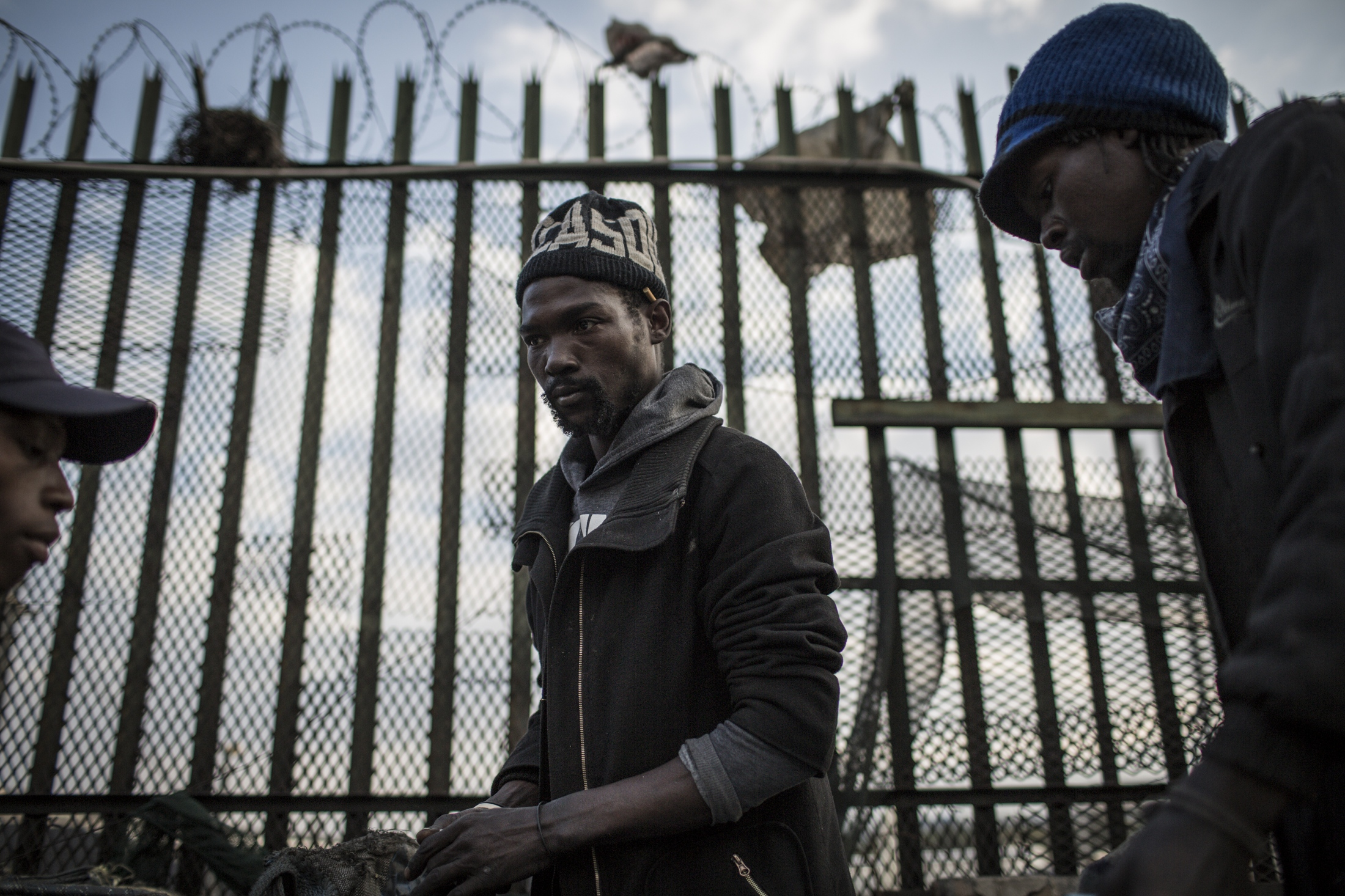 Melusi Ngoma (28) Vusi Matuna (28), Oscar Maile () buy back centre in Selby, Johannesburg where reclaimers bring waste to be weighed and sold.
