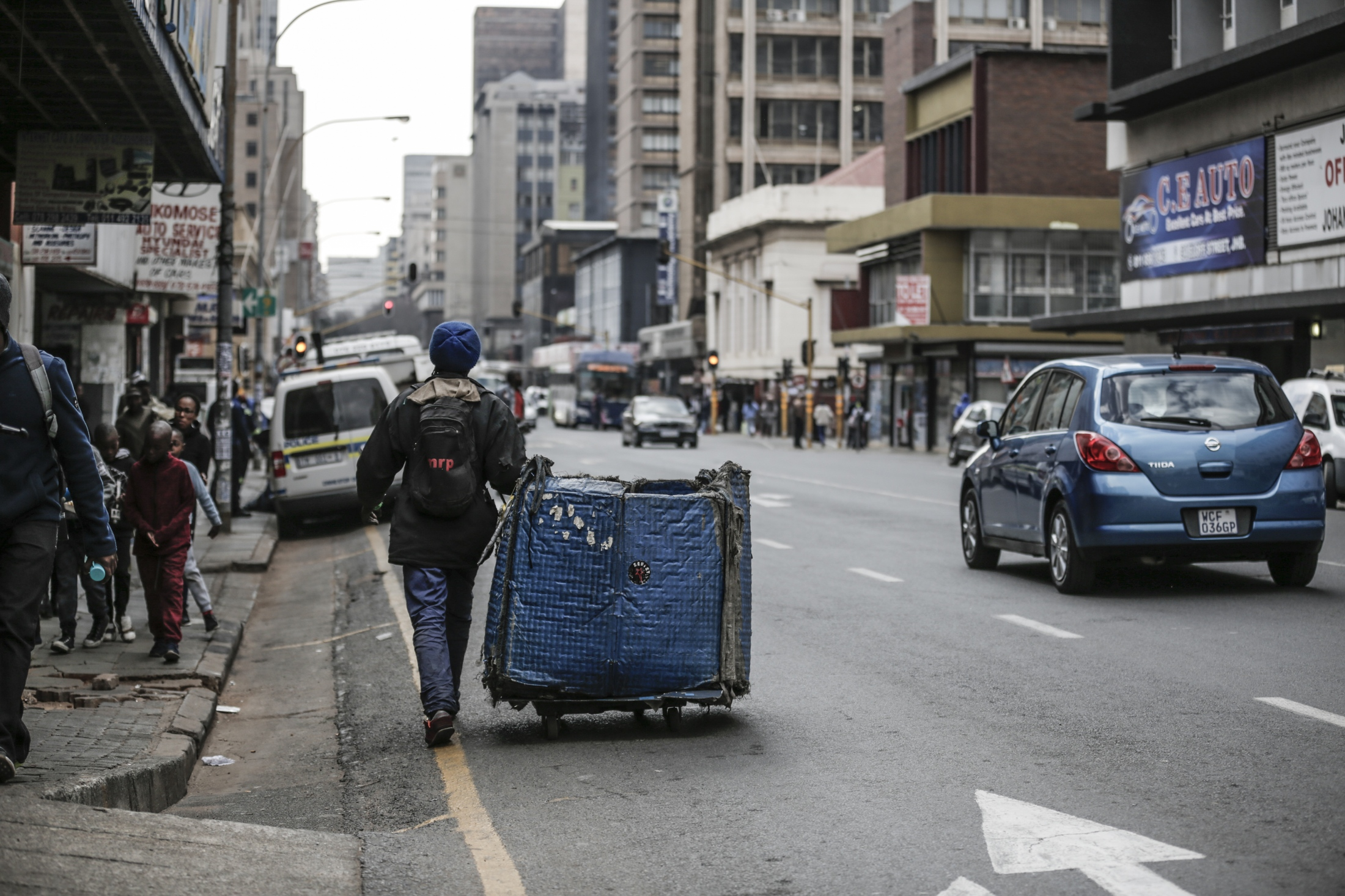 Oscar Maile, 29, pulls his trolley as he collects waste in Johannesburg city. Maile has been doing this for three years and says there are often fights on the streets with other reclaimers. He sometimes does two or three rounds collecting waste to earn enough for the day.  Each round paying him R30 - R40 which is the equivalent of approximately $2.