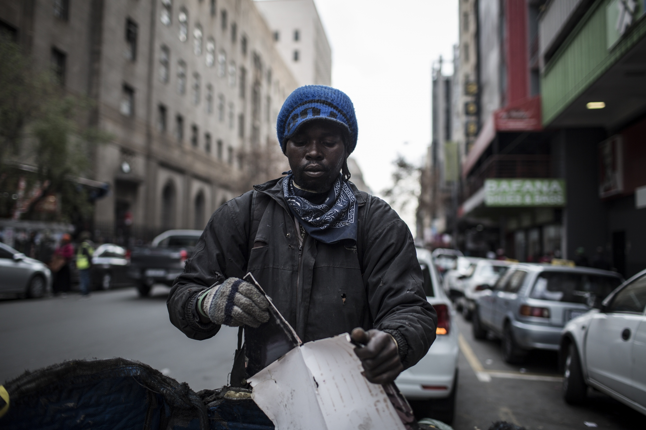 Oscar Maile, 29, collects waste in Johannesburg city on June 27, 2018.