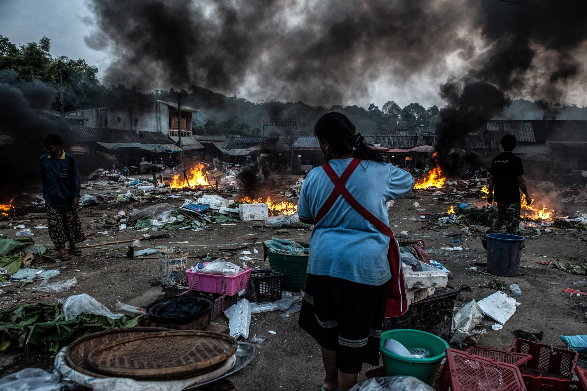 In the period of the smoggy season in Northern Thailand. Most of the activities that involve with burning are blamed to be the caused of smoke crisis. Local villagers in Tak province are burning plastic waste in fresh the market.