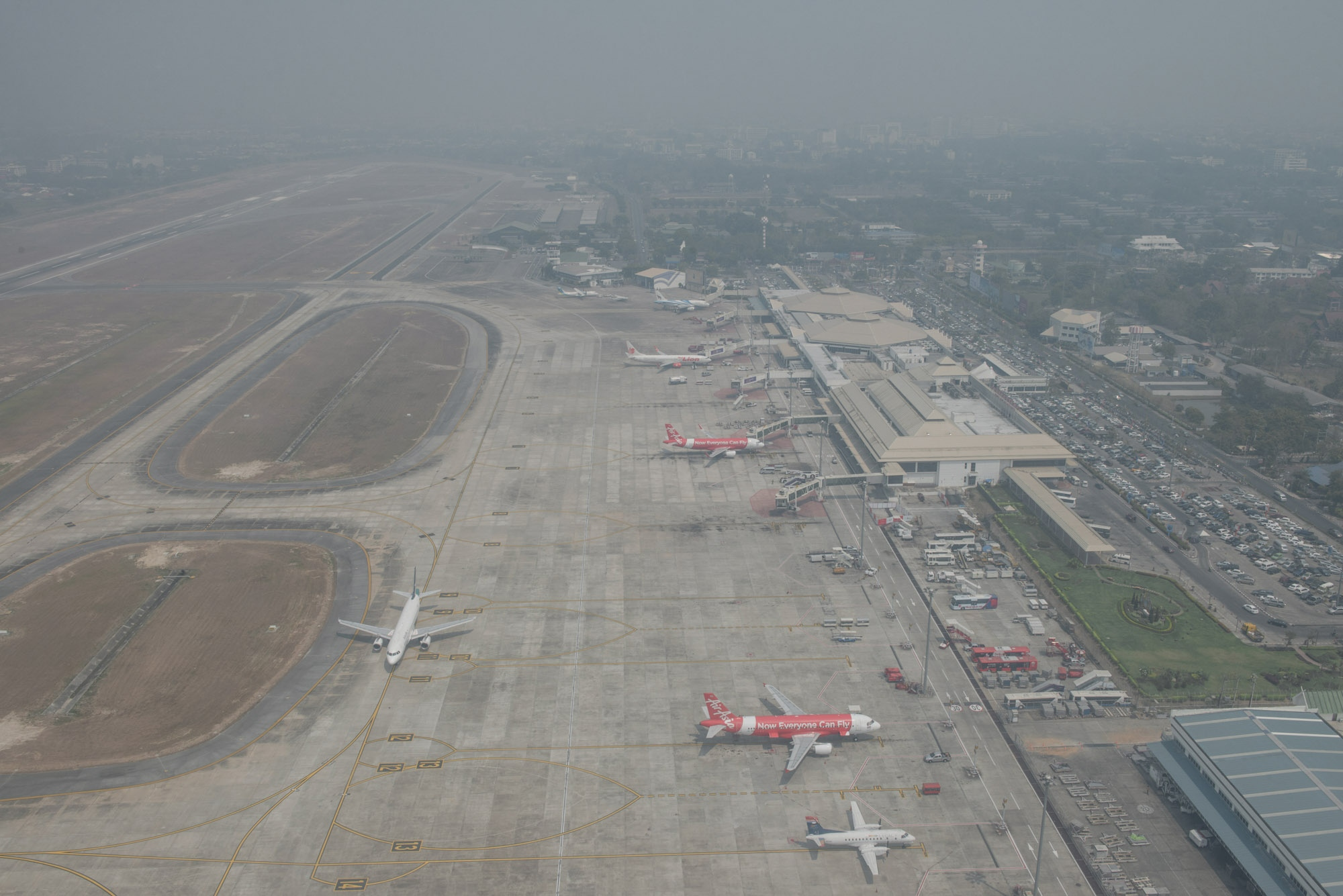 City areas are covered in haze. Flights have been scrapped or delayed as misty fog hung over the airport.
