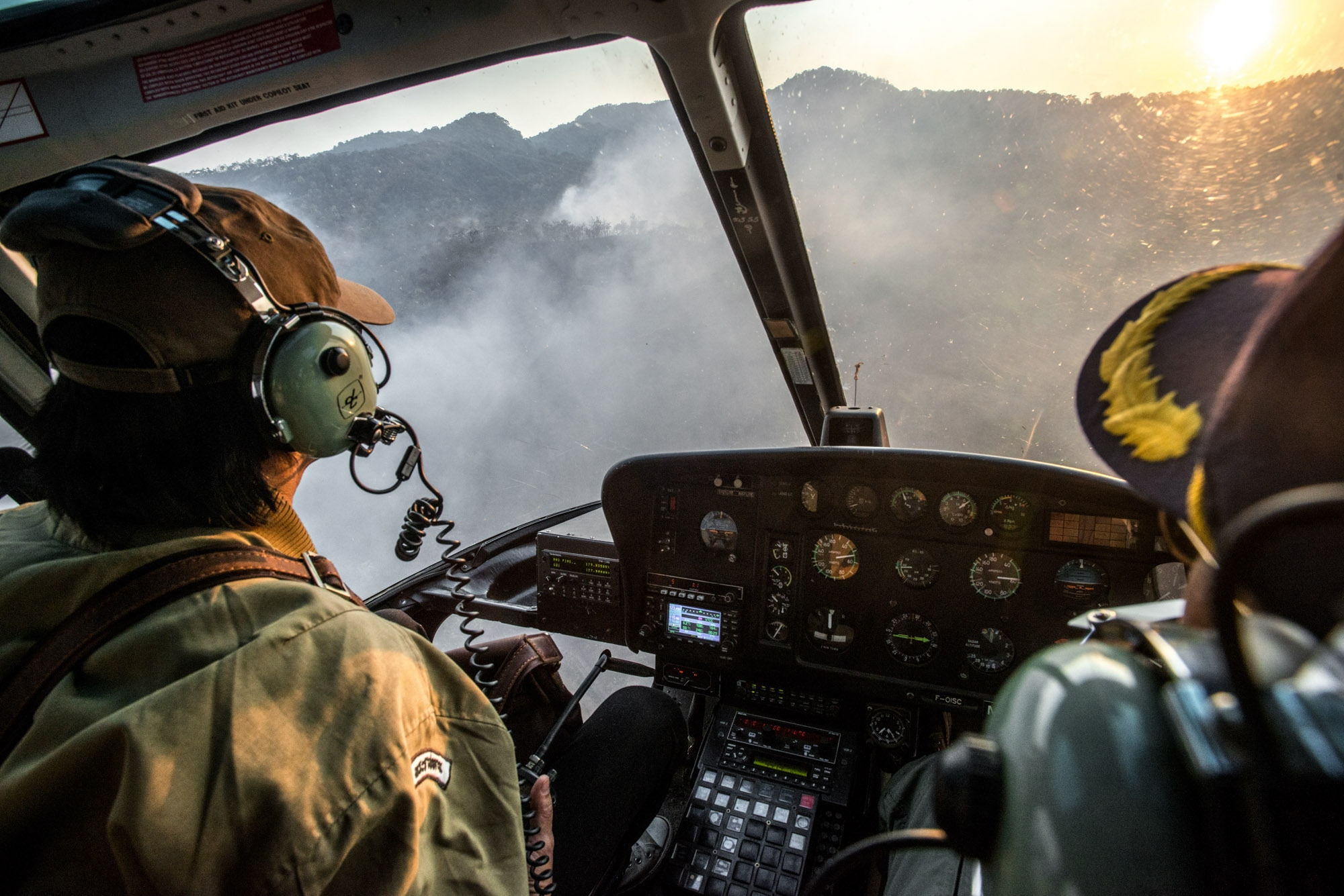 Aerial firefighting operation. The use of a helicopter to help report forest incidents for fire ground operation.
