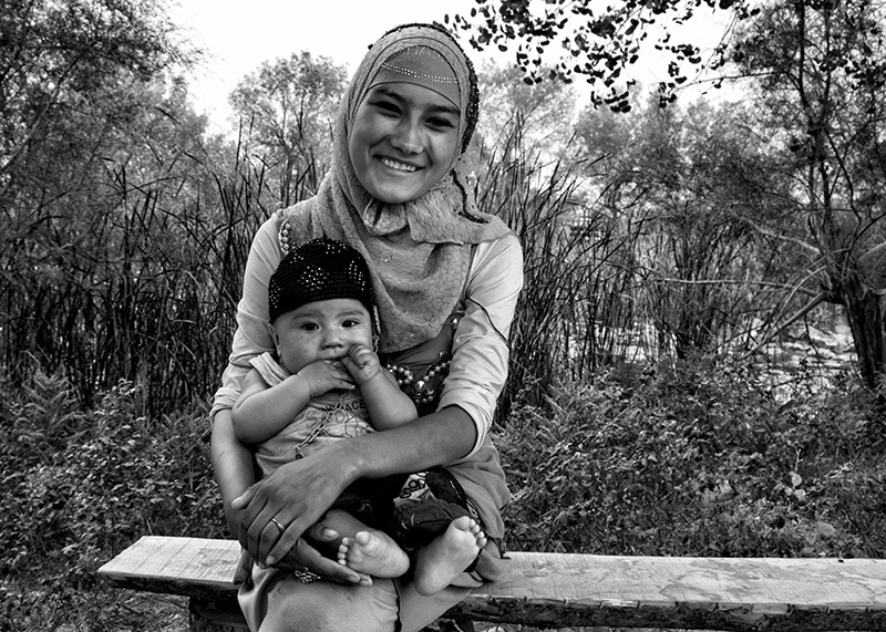 Photography image - A Muslim mother and son in Uighur Autonomous Region, Xinjiang, China