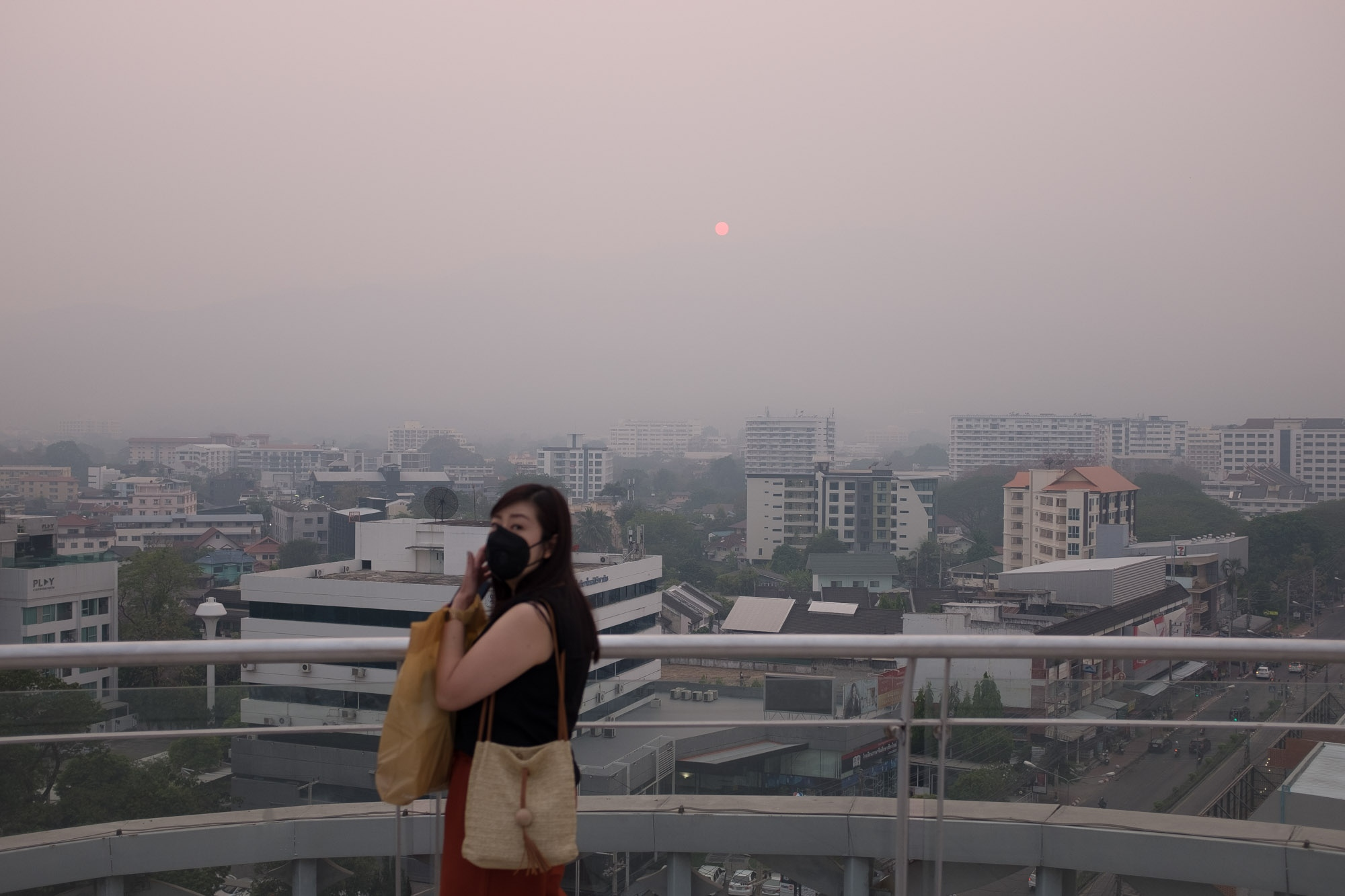 In the evening at the view point on top of the Maya shopping mall, usually are able to see the iconic mountain of Doi Suthep. Due to the heavily smoke arises at it's peak. The mountain disappeared into the smog. Chiang Mai, Thailand.