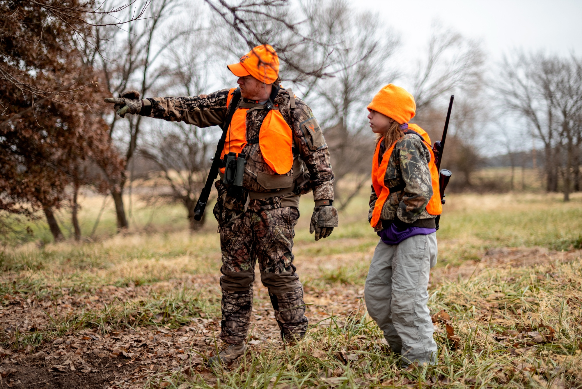 """Michael Jennings shows his daughter Callie Jennings a spot on a nearby tree where a buck has been licking the end of a branch on November 18, 2018 outside Centralia, Mo. """"I had never seen that before,"""" Callie Jennings said, """"[They do that] to leave their scent so that way they can attract does."""""""