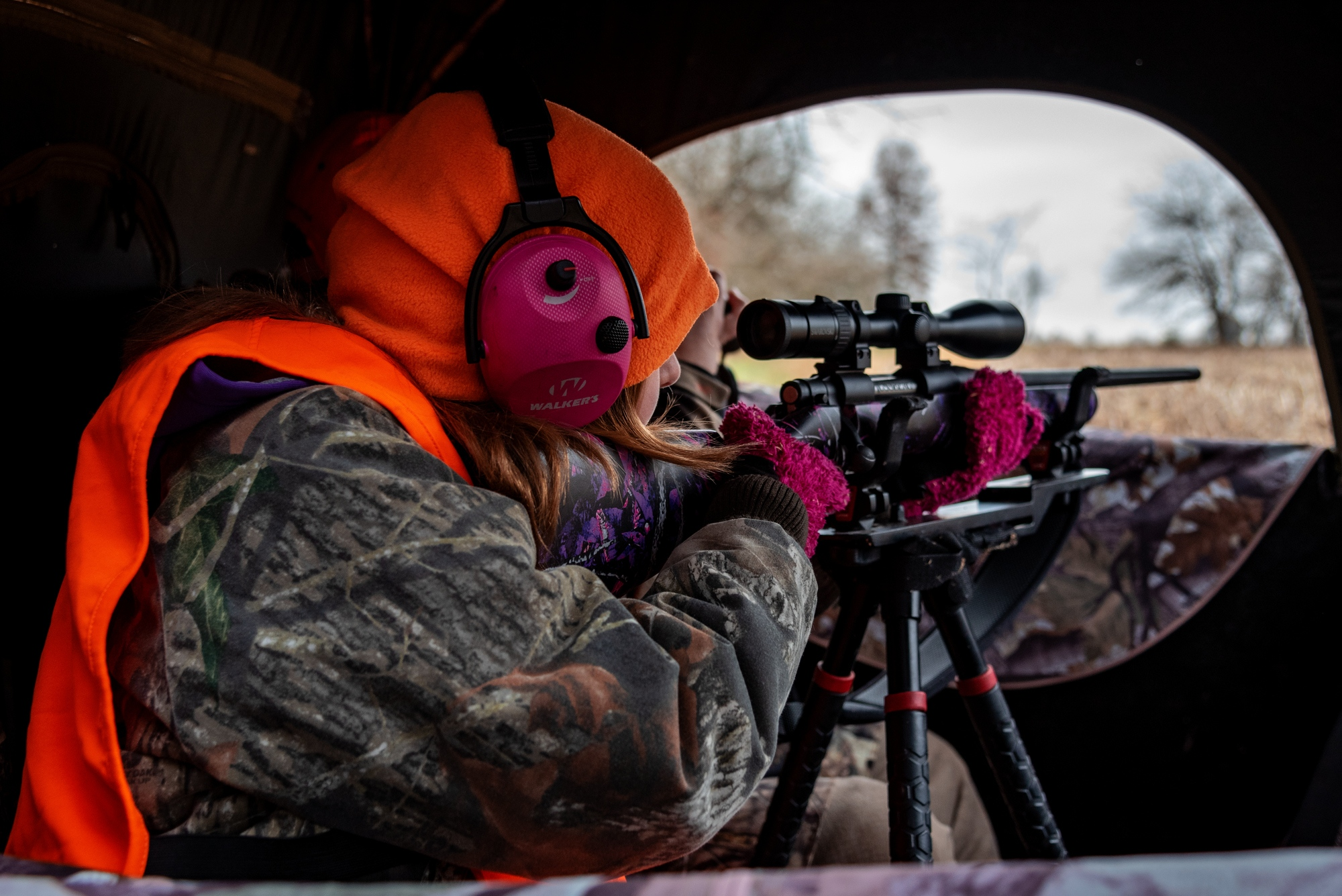 "Callie Jennings aims at a doe which walked out into the field in front of her on November 18, 2018 outside Centralia, Mo. Callie missed the deer and wound up going home empty handed that day. Callie said she rushed her shot and afterwards kept thinking: ""darn it, I should have just killed it."""