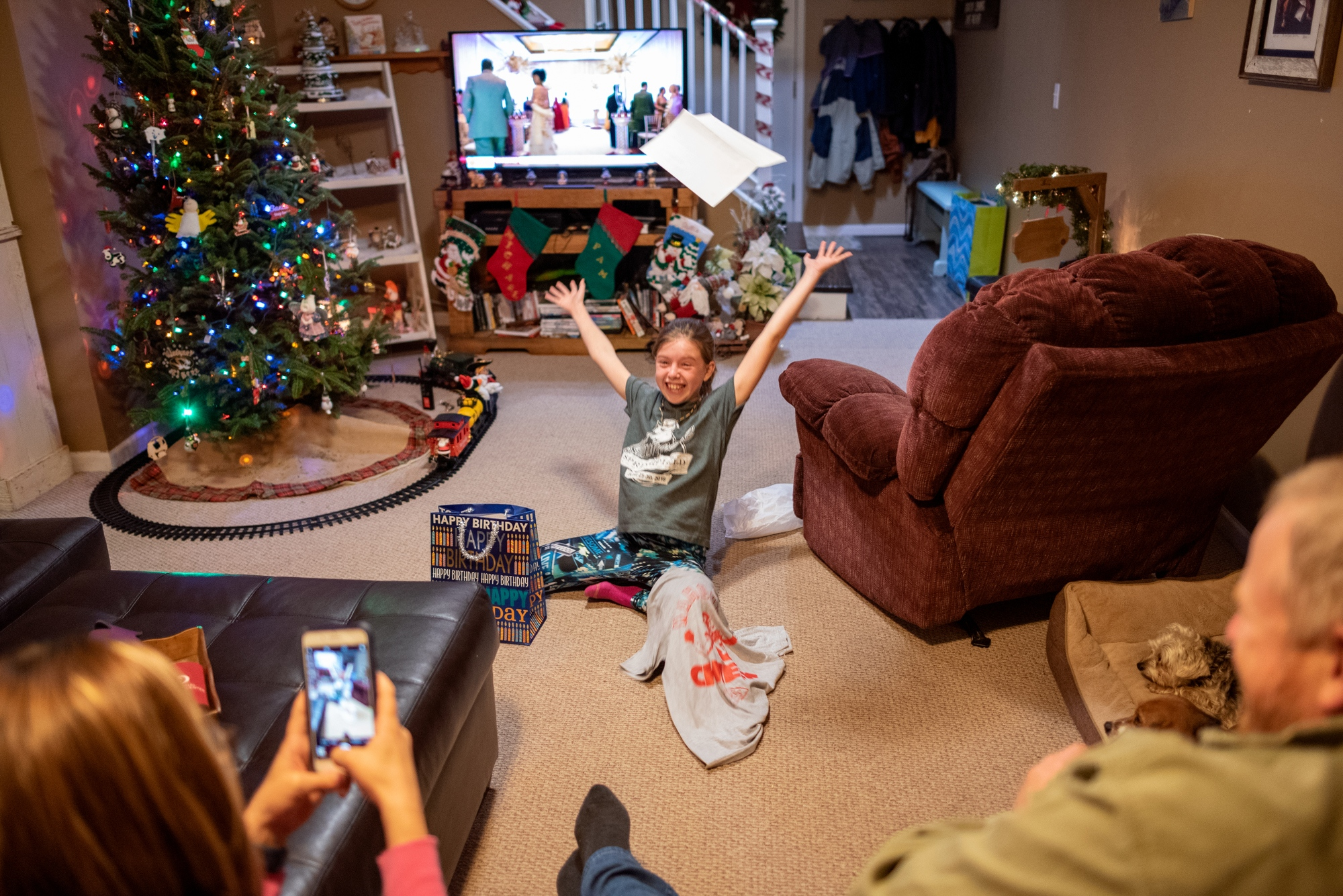 Callie Jennings tosses her birthday present, a ticket to country musician Kane Brown's concert, in the air in excitement on November 26, 2018 north of Columbia, Mo. Brown is Callie's favorite country music star.