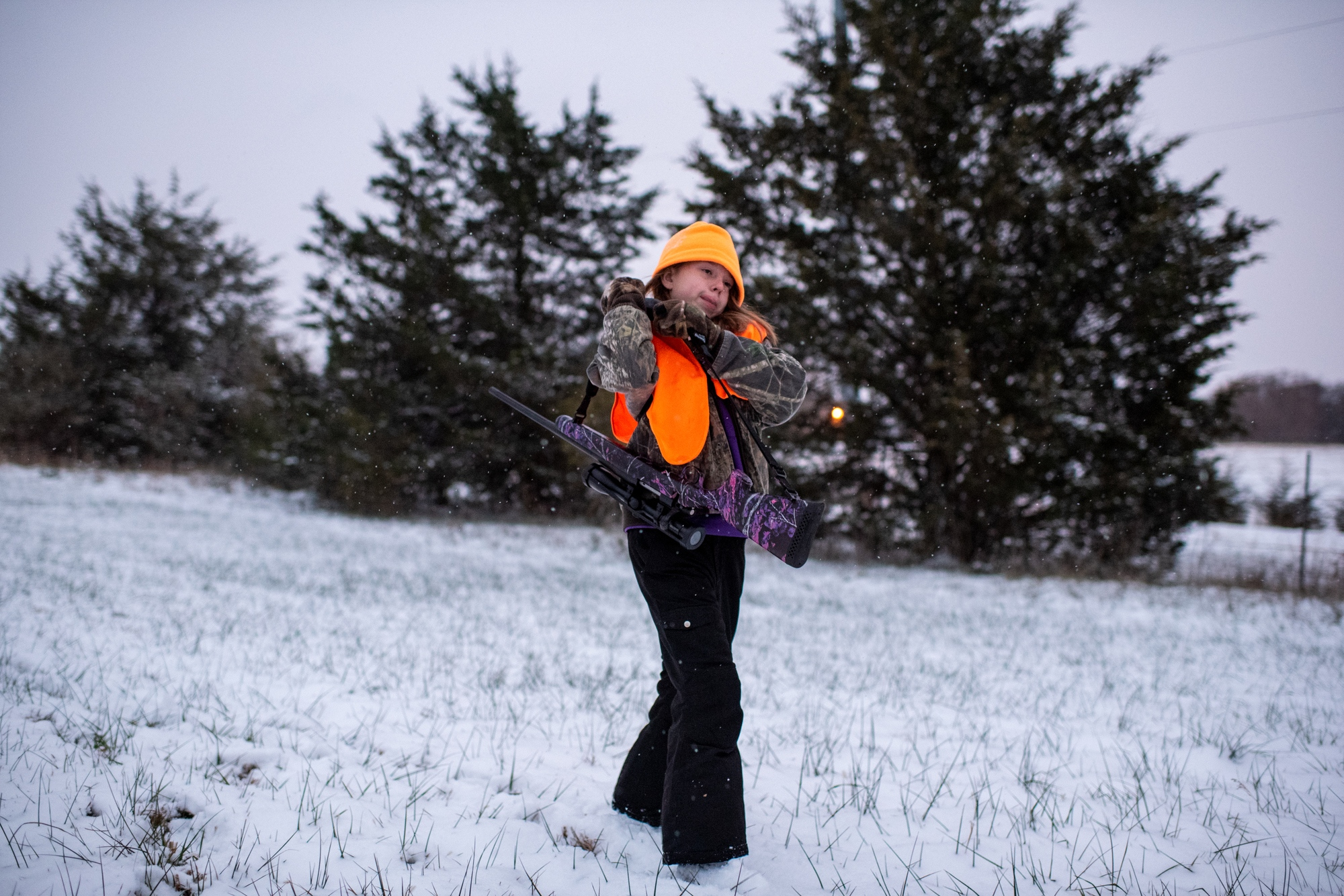Callie Jennings shoulders her rifle after an afternoon of hunting on her family's land. Callie didn't see any deer that day but said she's glad for the experience even though she didn't get anything. Michael Jennings said he hopes he's taught her skills she'll want to pass on to her kids someday.