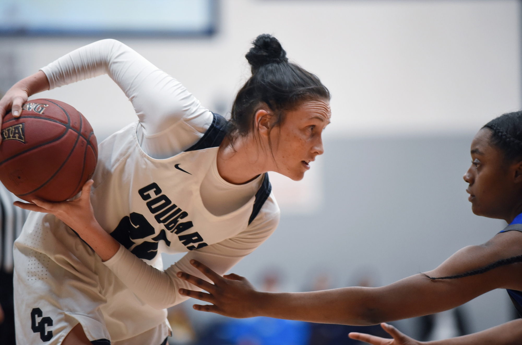 Columbia College guard Jordan Alford faces down Central Baptist's Antoinette Shrepee on Wednesday Feb. 27, 2019 at the Southwell Complex in Columbia. The Cougars faced off against the Mustangs in the first round of the American Midwest Conference tournament.