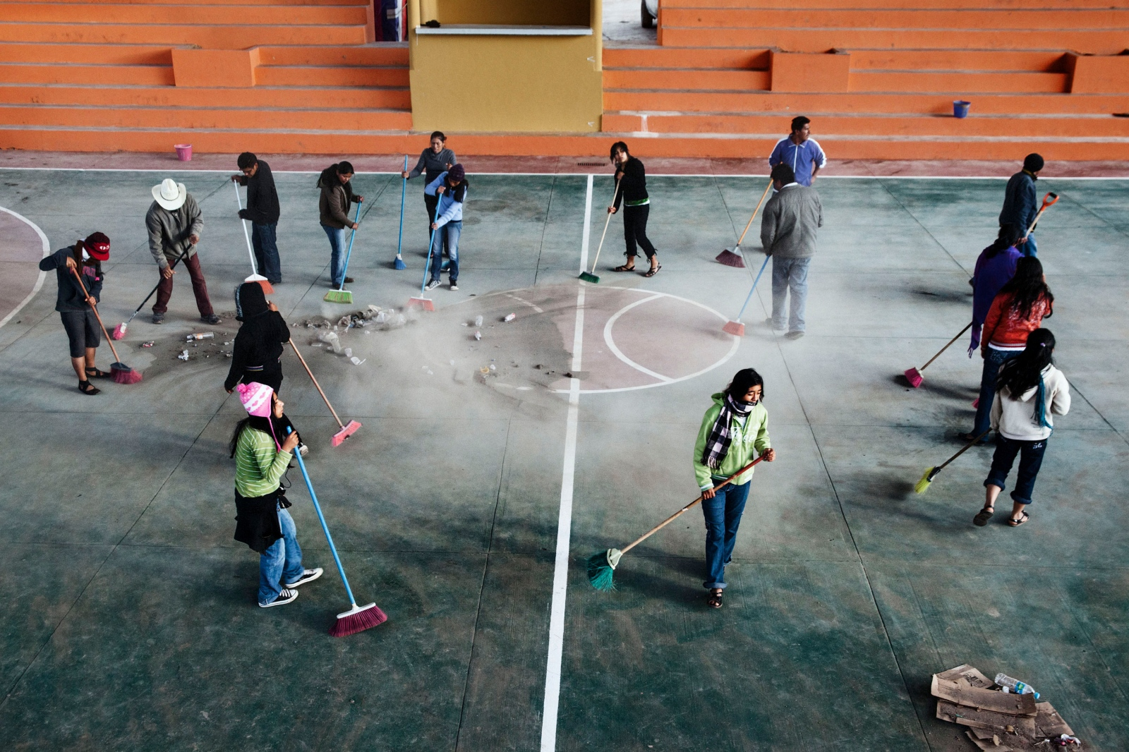 SANTA MARIA TLAHUITOLTEPEC, MAY 19, 2012.-Villagers from Tlahuitoltepec sweep the main basketball court to prepare it for the inauguration of the basketball tournament. In a community assembly they create commissions to organize the event. The commissioners are coordinated by the sporting authorities.