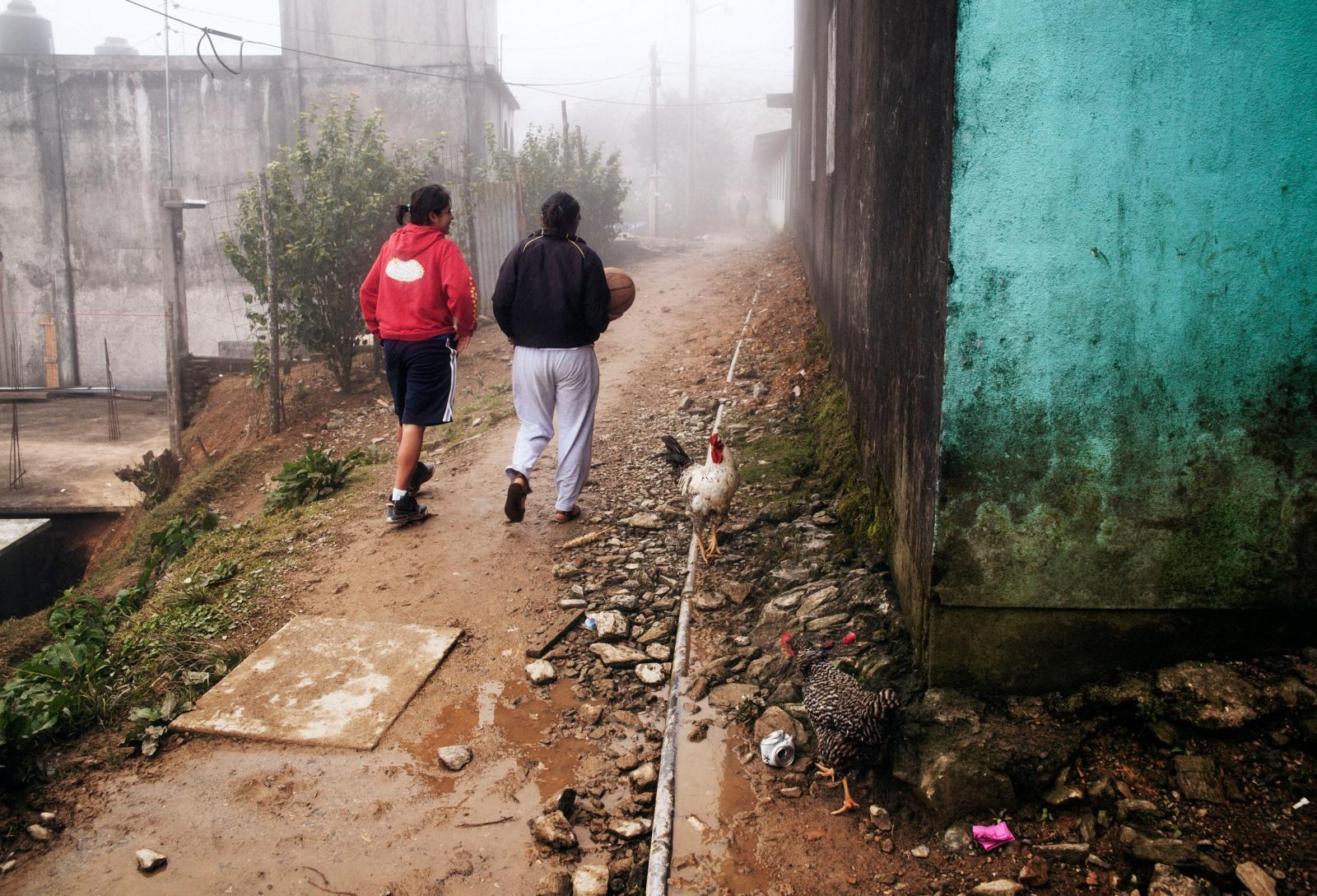 "SAN JUAN METALTEPEC,DECEMBER 9, 2012.- Players from the ""Las Abejitas"" team walk to the community's court."
