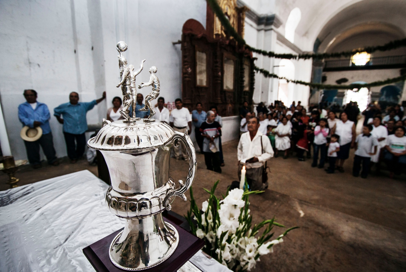 SAN CRISTÓBAL LACHIRIOAG, NOVEMBER 21, 2009. Villagers bless the first place basketball trophy in an early morning ceremony in San Cristobal Lachiroag. The trophy was valued at around $3,000.