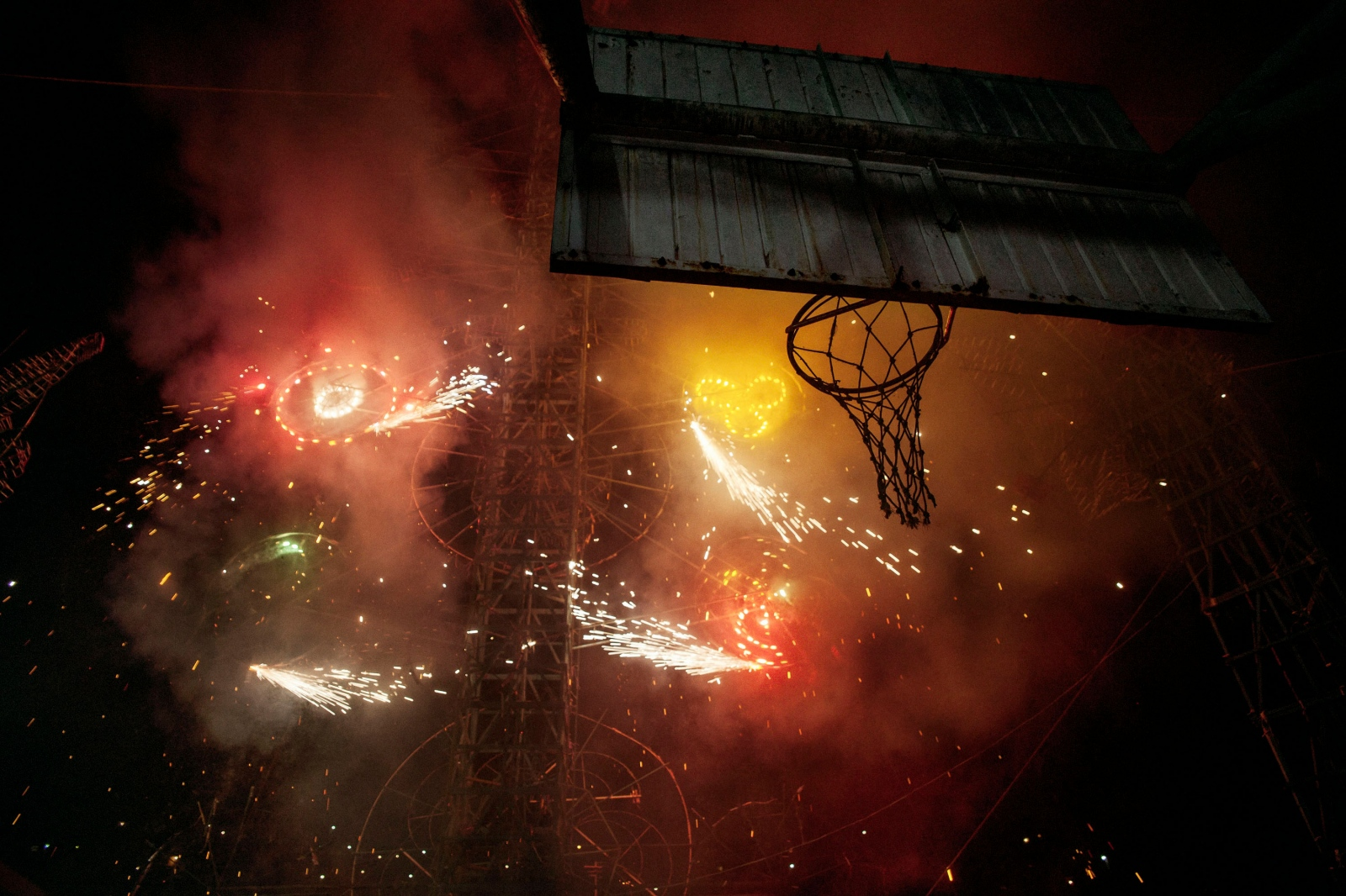 SAN CRISTÓBAL LACHIRIOAG, NOVEMBER 19, 2011. The firework castle explodes on the basketball court.