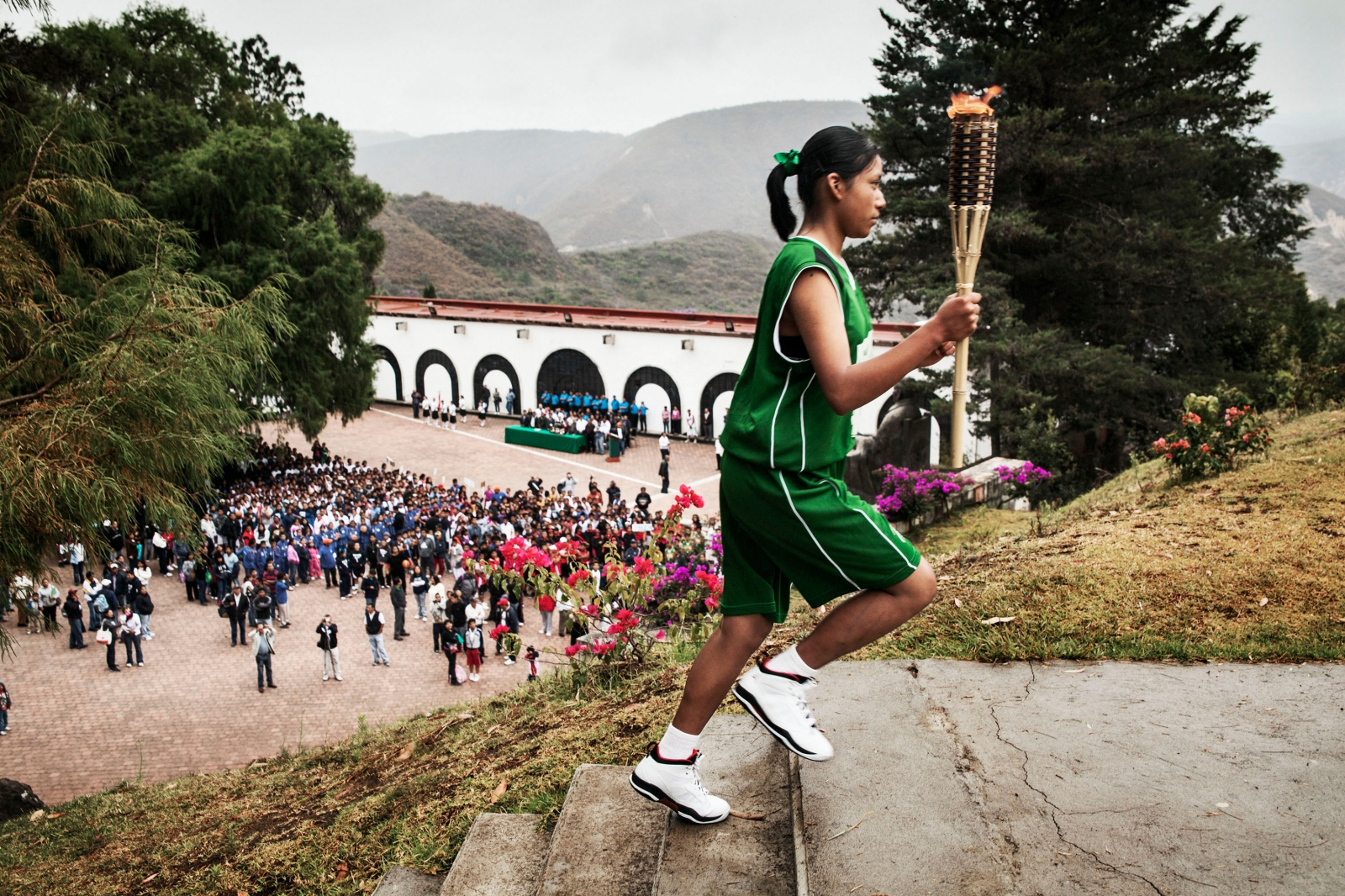 GUELATAO DE JUÁREZ, MARCH 10, 2012. Sandra Nayeli Pérez runs with the torch at the opening ceremony of the Copa Benito Juárez 2012.