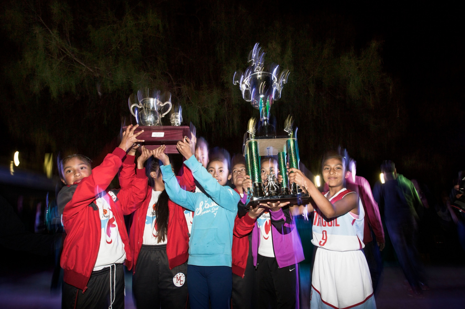 GUELATAO DE JUÁREZ, MARCH 21, 2016. Players from Macuiltianguis pose with the Benito Juárez Cup of the girl's category after winning the final match.