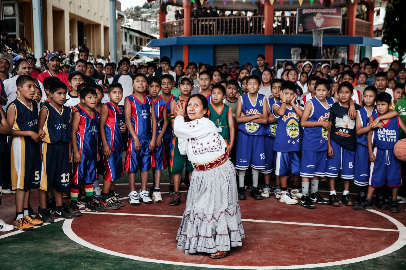 SANTA MARIA TLAHUITOLTEPEC, MAY 19, 2012. Tlahuitotepec's first female mayor Sofia Robles, takes the opening shot at the basketball tournament.