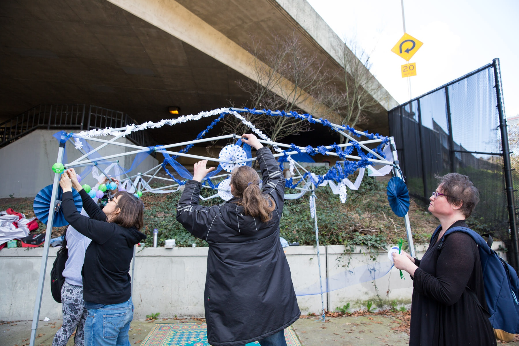 Volunteers decorating a wedding canopy.   For the New York Times