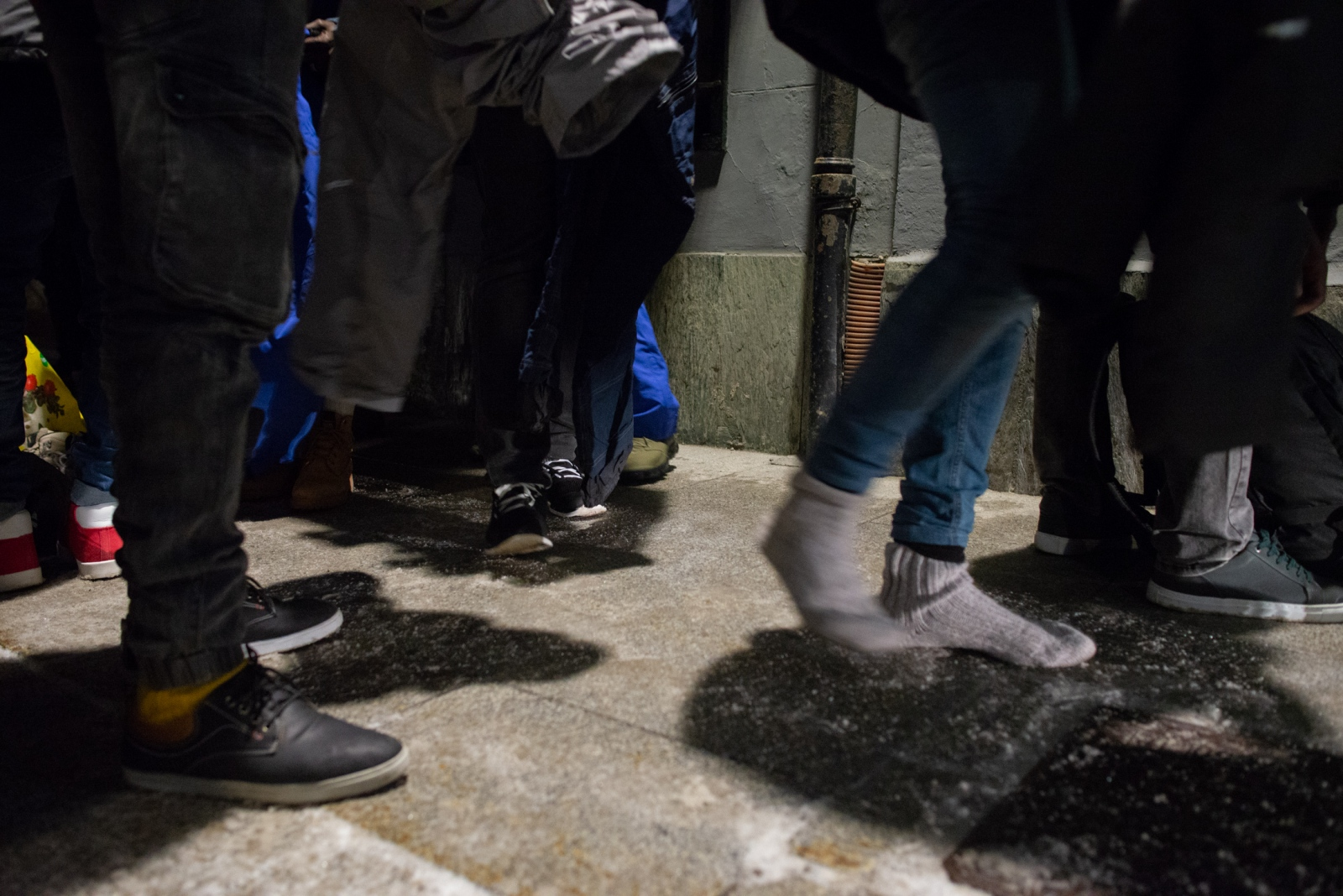 Homeless asylum-seekers are trying on winter shoes and appropriate winter gear donated by locals. When asked, many migrants replied they where going to try to hike into France in the coming days.Northern Italy - December 2018.
