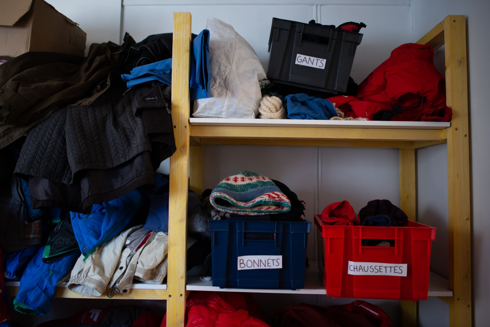 Donated winter gear is stocked in the patrolling team's office.  Volunteers carry extra winter, as many rescued migrants do not have the appropriate clothes for freezing temperatures.  Briançon, France - January 2019.